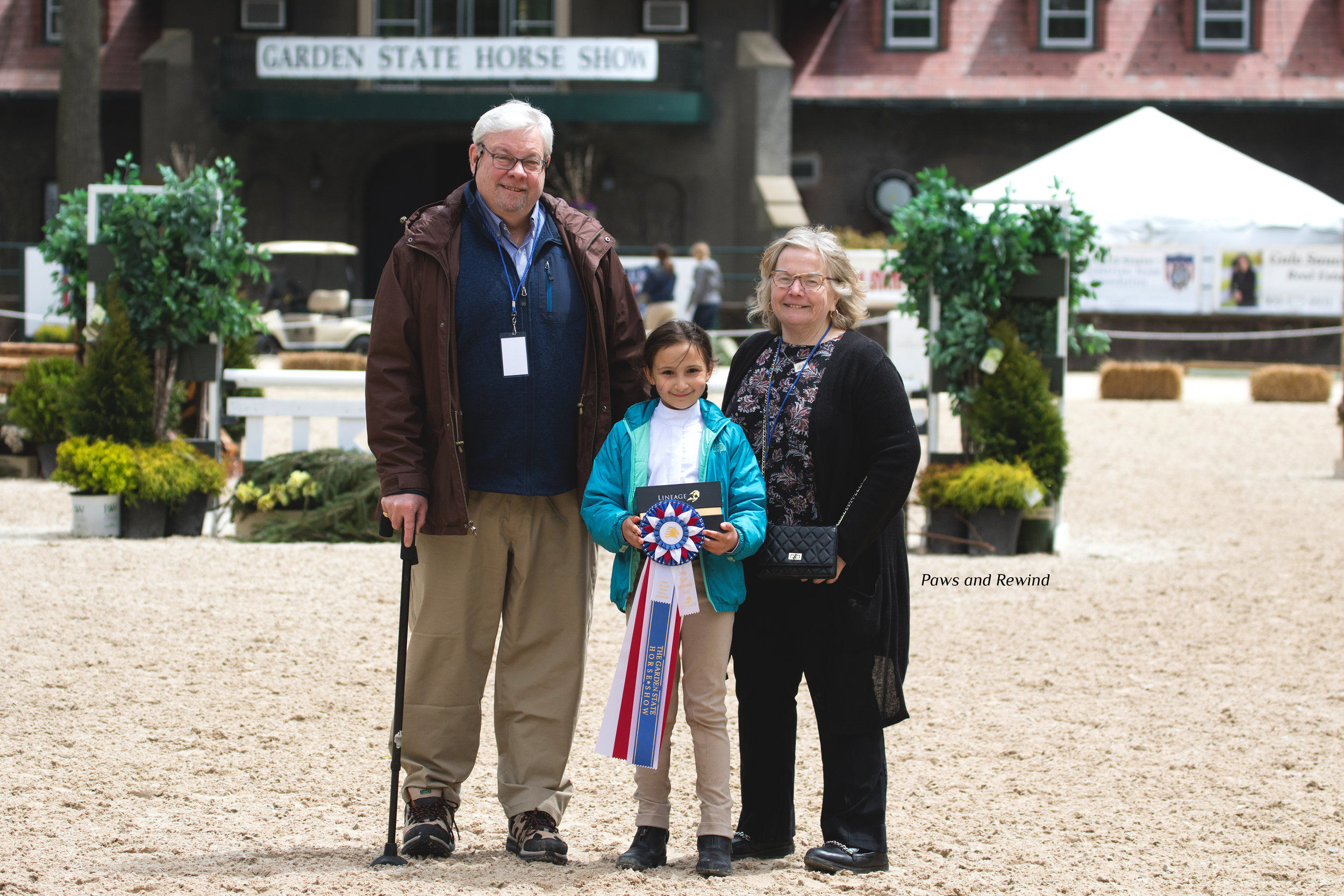 Kaylee Falt with Kim and John Walker of the Junior Essex Troop. Photo by Paws and Rewind