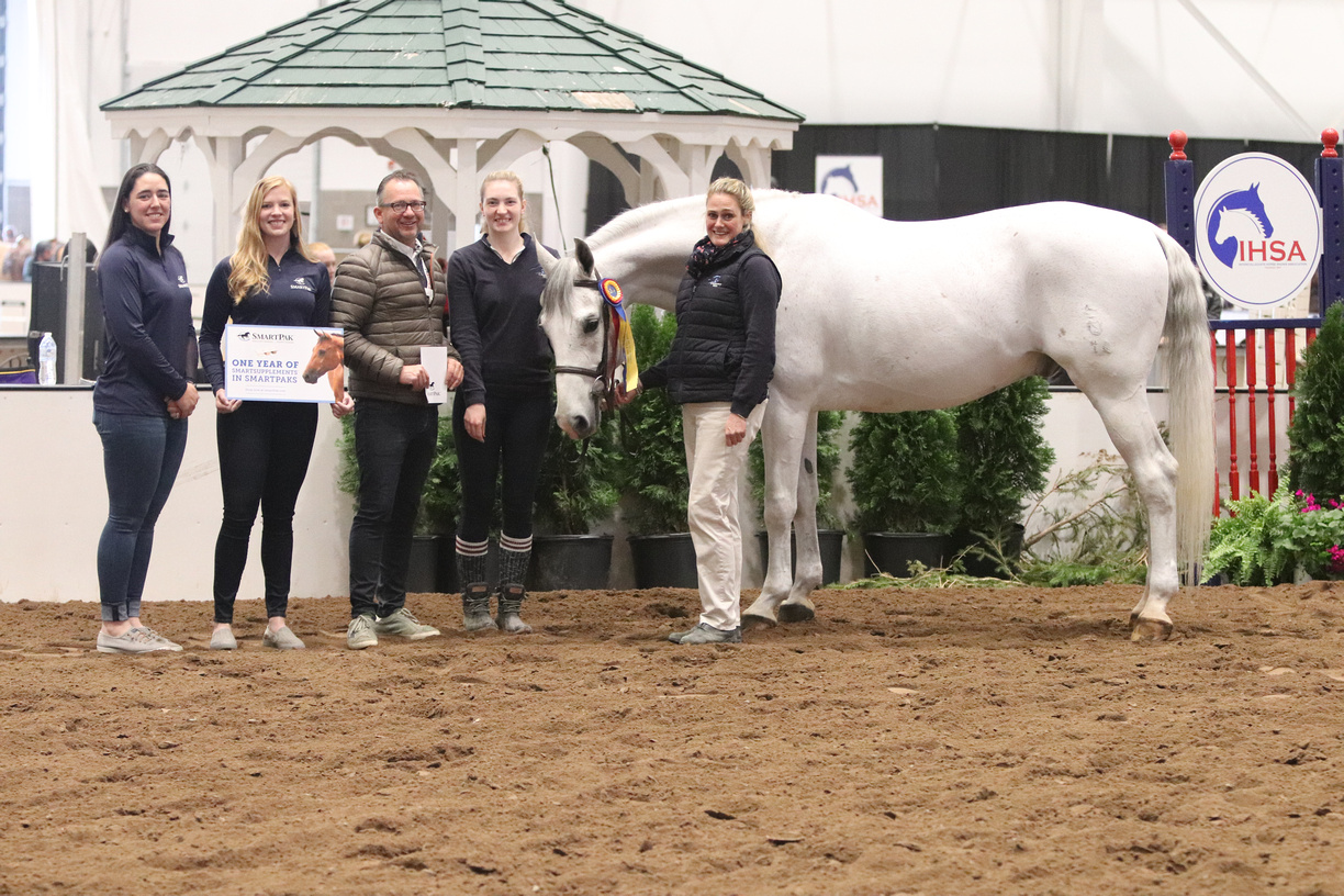 Centenary University's coaches Michael Dowling and Heather Clark with their rider Meghan Frederick and Centenary University's Lucky, the SmartPak Most Popular Hunter Seat Horse and Triple Crown High Point Horse award. Photo by alcookphoto.com