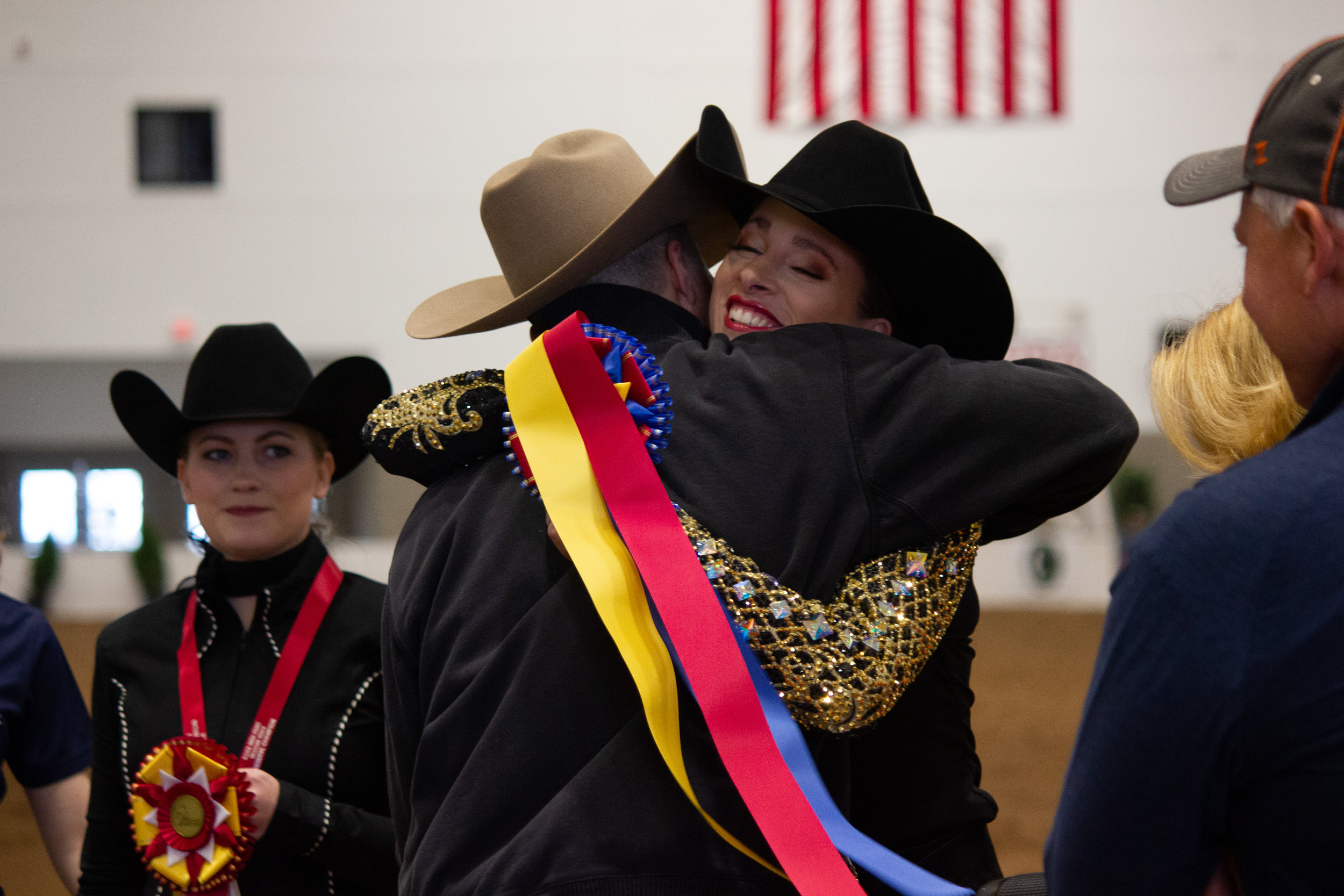 Julia Roshelli after winning the AQHA High Point Rider title, she receives congratulations from   her coach Spencer Zimmerman. Photo by Ellyn Narodowy