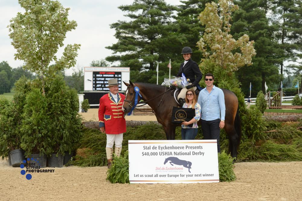 John Franzreb with sponsors Maxime Tyteca and Niels Haesen from Stal De Eyckenhoeve present the award to Maria Rasmussen and Connor for their win of the $20,000 Open Section of the USHJA National Hunter Derby. Photo by Anne Gittins Photography
