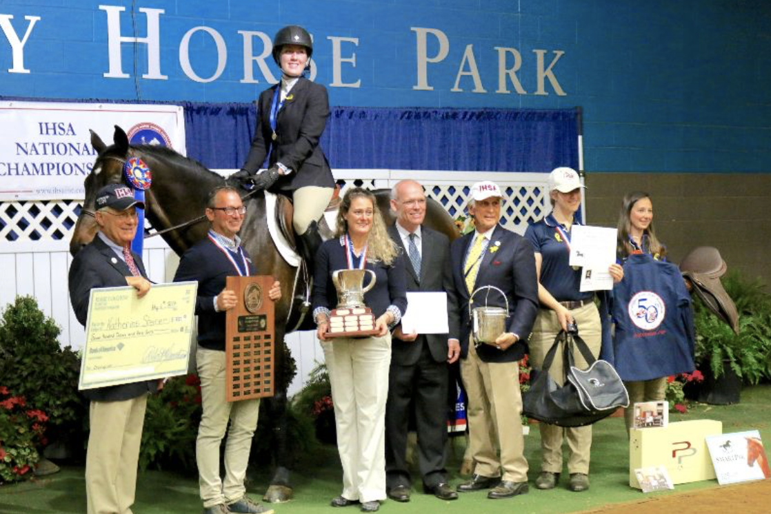 Heather Clark and Michael Dowling hold the trophies for their student and 2017 USEF Cacchione Cup winner Katherine Steiner. Tom Cacchione on left with Bill Moroney and Bob Cacchione on the right. Photo by Tyler Van Velsen