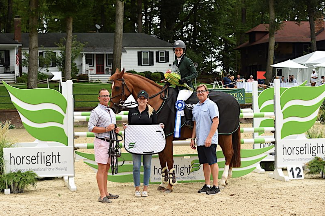 Co-owners Michael Dowling and Tucker Ericson along with Kaylee Donahue from Redfield Show Tack presented the award to Sima Morgello who won the $10,000 Mini Prix, sponsored by Horseflight, at Monmouth at the Team in 2018. Photo by Anne Gittins Photography