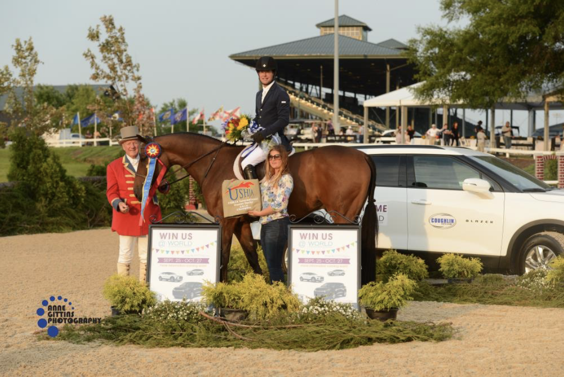 Ringmaster John Franzreb and Stal De Eyckenhoeve's Maxime Tyteca present the award to Peter Pletcher and Quintessential for their win in the $30,000 USHJA International Hunter Derby, sponsored by World Equestrian Center. Photo by Anne Gittins Photography