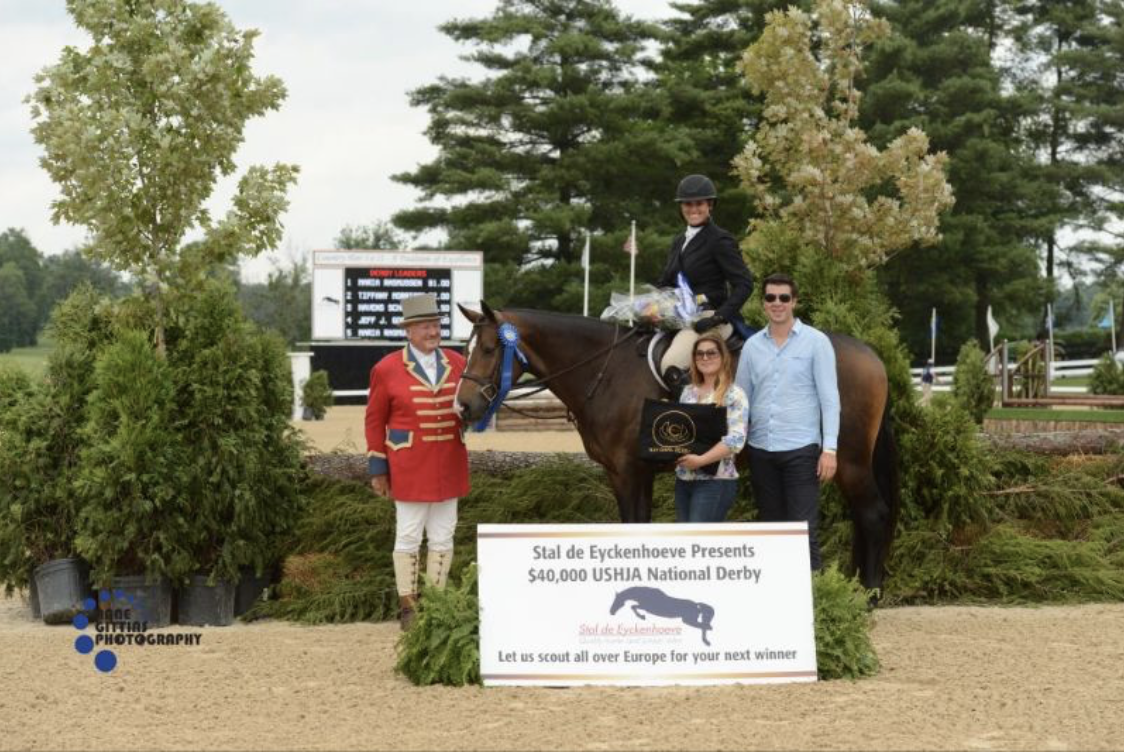 John Franzreb with sponsors Maxime Tyteca and Niels Haesen from Stal De Eyckenhoeve present the award to Maria Rasmussen and Connor for their win of the $20,000 Open Section of the USHJA National Hunter Derby.Photo by Anne Gittins Photography