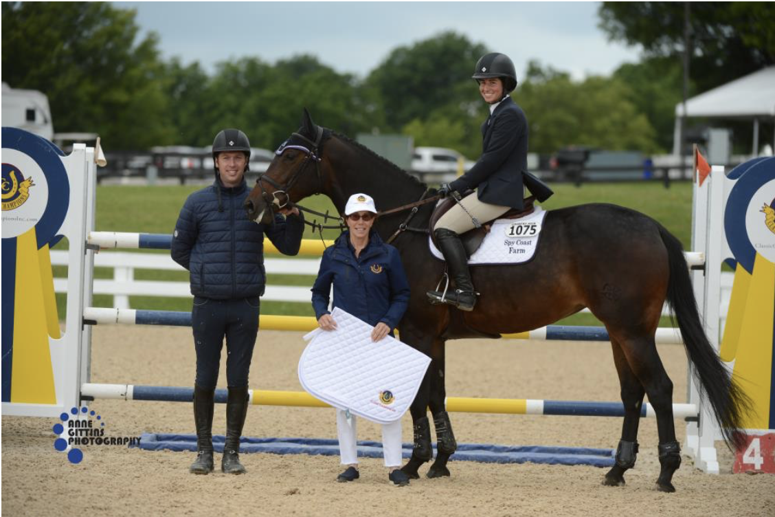 Cynthia Hampton from Classic Champions, Inc.presents the award for the champion of the 7-Year-Old Young Jumpers Maui SCF ridden by Jennifer Waxman. Photo by Anne Gittins Photography
