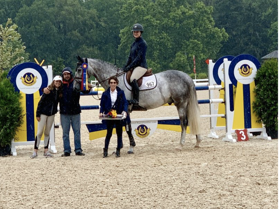 Cynthia Hampton presents the award to Hayley Barnhill and Country Heir Week I 7-Year-Old Young Jumper Champion Higuain. Photo by Anne Gittins Photography