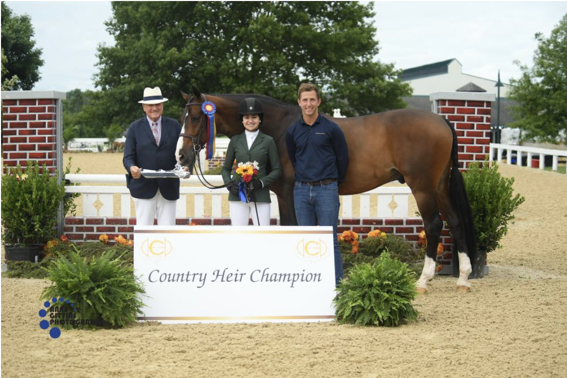"""John Franzreb presents the championship of the 3'3"""" Junior Hunters 15 and Under to Mia Chimenti and Ericsson with trainer Michael Meyers. Photo by Anne Gittins Photography"""