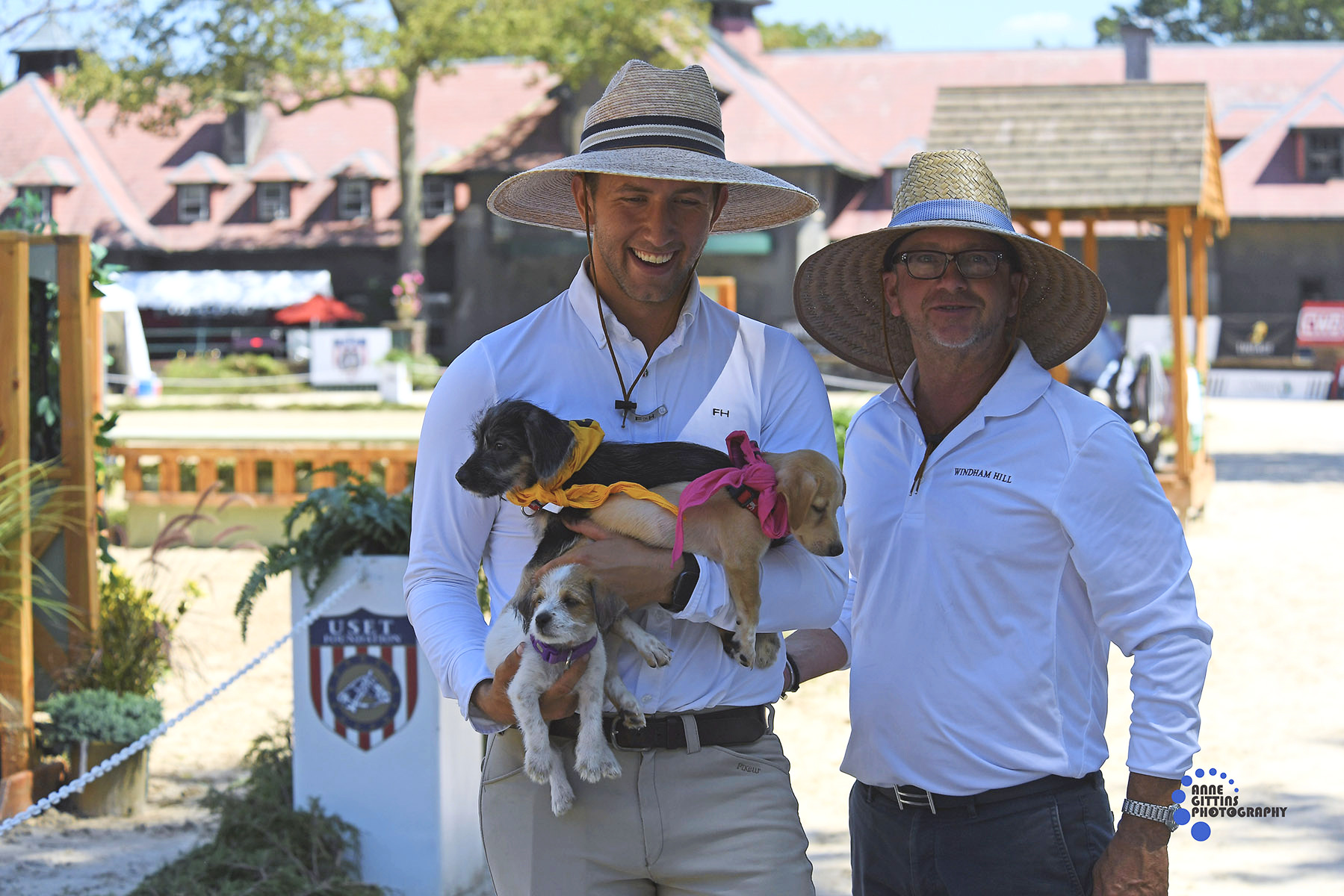 Windham Hill's Michael Meyers and Michael Dowling made fast friends with puppies available for adoption through Punta Santiago Dogs. Photo by Anne Gittins Photography