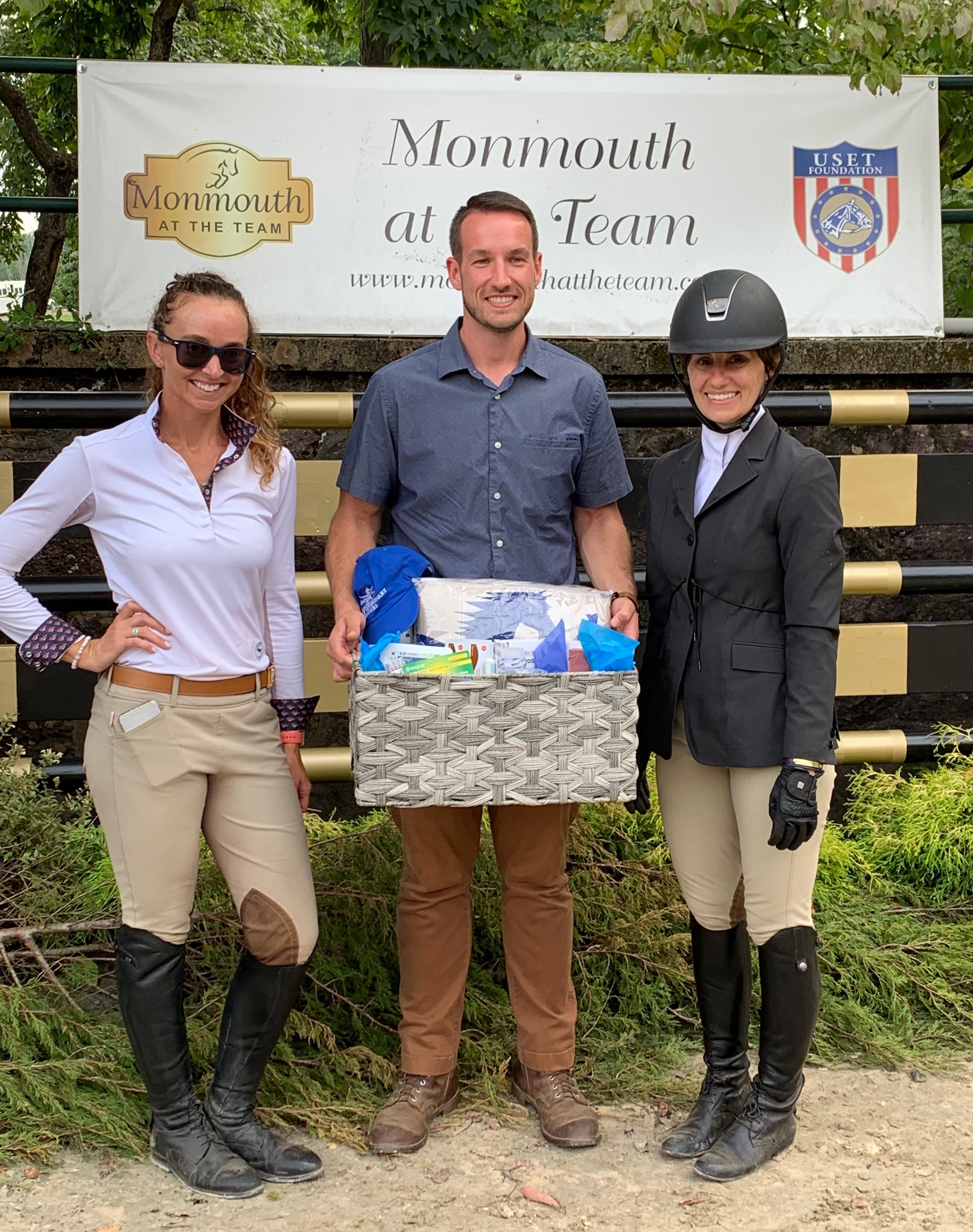 Dr. Travis Bowers presented the prize for the Running 'S' Equine essay contest to Jenny Murphy and Patricia Cleary. Photo by Dr. Amy Gregonis