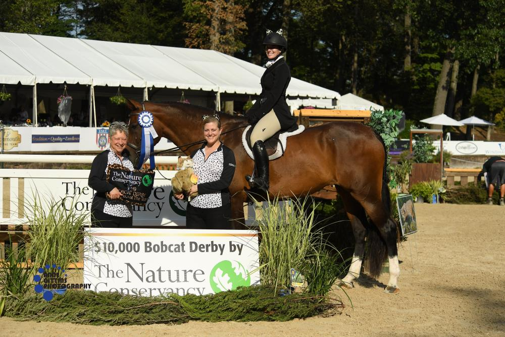 "Barbara Brummer, The Nature Conservancy's New Jersey State Director, and Mary Conti, Director of Marketing, present the award for the 2'' and 2'6"" section of the $10,000 Bobcat Derby to Evelyn Smith and C'est A Dire Z . Photo by Anne Gittins Photography"