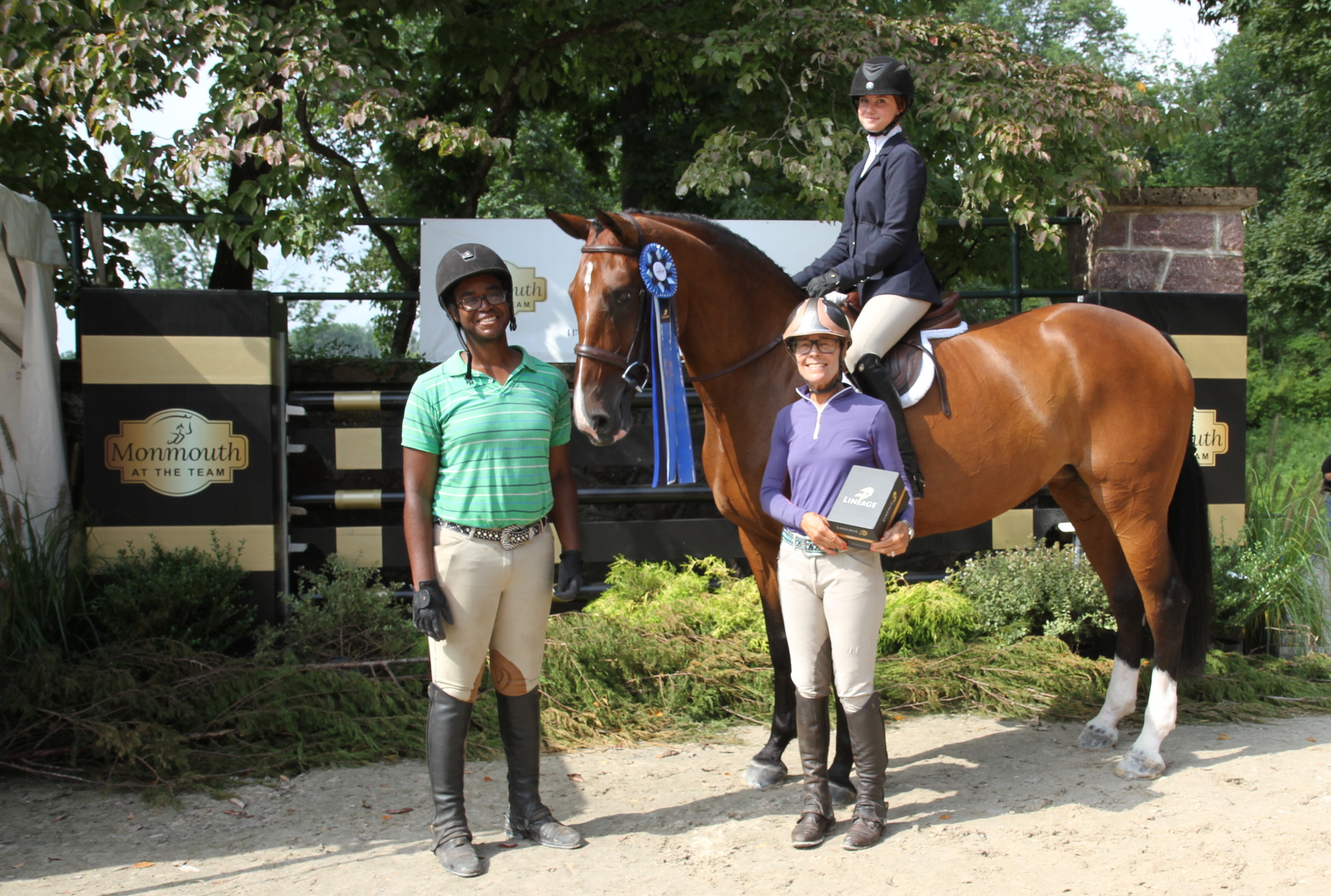 Carmella Cacciatore won Wednesday's Sportsmanship Award and was presented with a pair of Lineage stirrups. She is aboard Catherine the Great with Charles Brown and Penny Kinnally. Photo by EQ Media