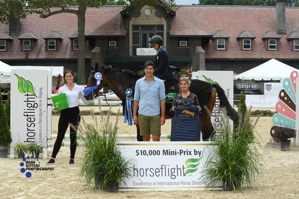 Devon Kaminsky from Horseflight presented the award to Hunter Champey and Caprice for their win in the $10,000 Mini Prix, sponsored by Horseflight. Niels Haesen and Maxime Tyteca from Stal De Eyckenhoeve presented the Top Trip of the Day award to Champey. Photo by Anne Gittins Photography