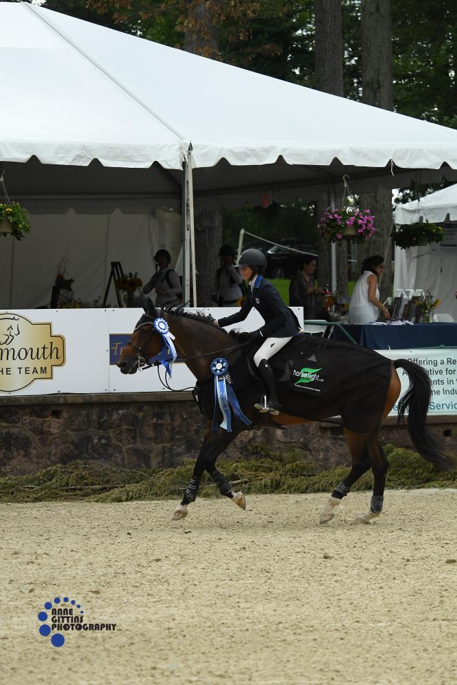 Hunter Champey and Caprice take their victory gallop. Photo by Anne Gittins Photography