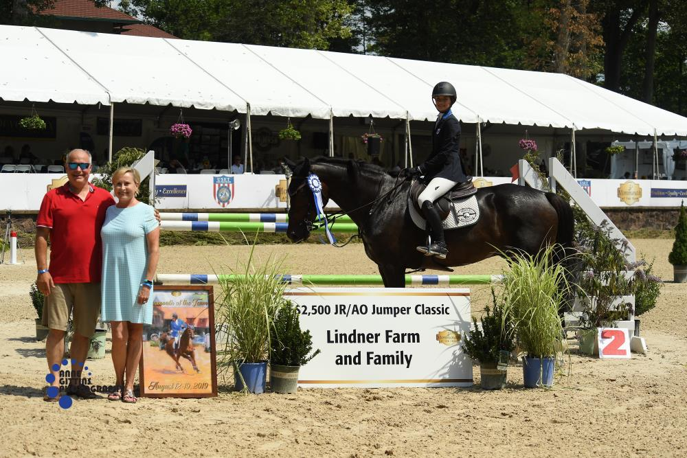 The Lindner Family presented the award for the $2,500 Junior/Amateur-Owner Jumper Classic to Christina Kourgelis and Mitesche. Michael Mastice and Lexus won the $2,500 Low Child Adult Jumper Classic, sponsored by Zeus Scientific, and the $1,500 1.0m Jumper Classic, sponsored by Red Oak Farm. Photos by Anne Gittins Photography