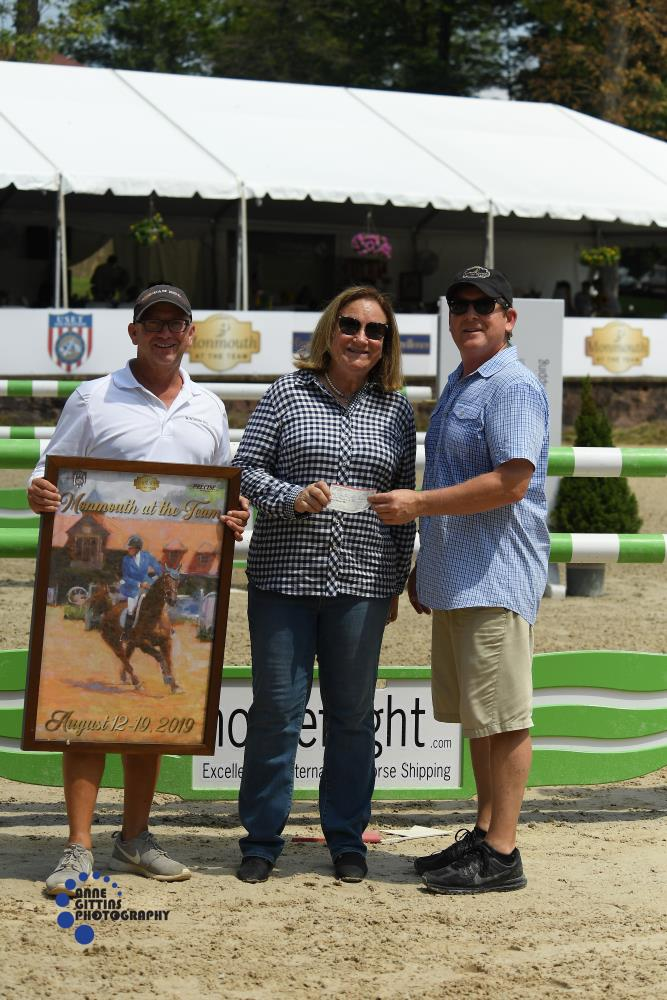 Monmouth at the Team co-owners Tucker Ericson and Michael Dowling made a special presentation to the Equestrian Aid Foundation. Marilou Case, a member of their leadership team, was on hand to accept the donation. Photo by Anne Gittins Photography