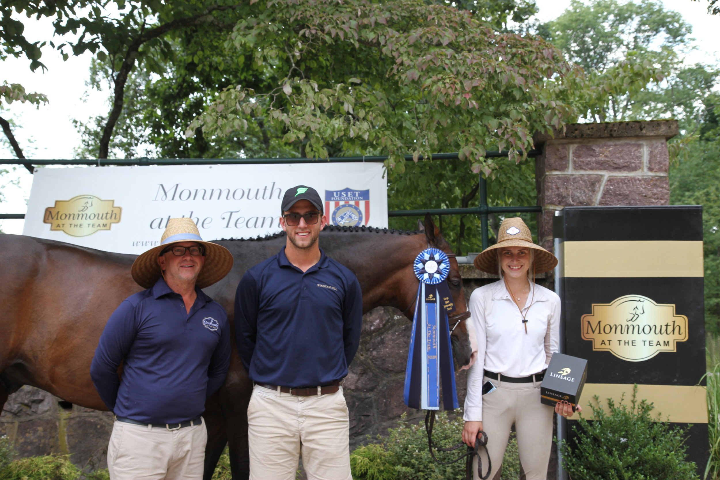 Madison Myro was presented with the Lineage Sportsmanship Award and went home with a new pair of Lineage stirrups. Myro accepted the award wiith her Windham Hill trainers Michael Dowling and Michael Meyers. Photo by EQ Media