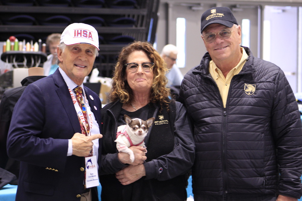 Bob Cacchione with Sherry and Peter Cashman and their Chihuahua Piper.   Peter Cashman will take over as IHSA interim executive director. Photo by Nicole Sullivan