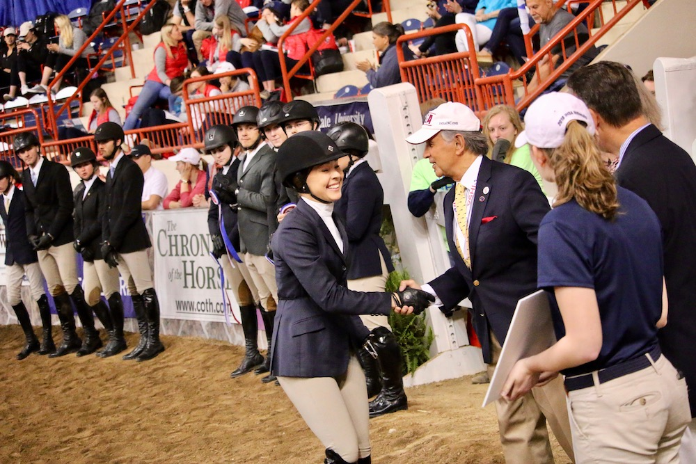 Bob Cacchione shakes Lizzy Traband's hand during Nationals at Harrisburg in 2018.    Photo by Madison Dempster