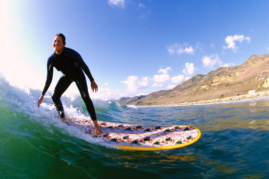 Pamela Clark surfing, taken by  David Pu'u  on the California coast.