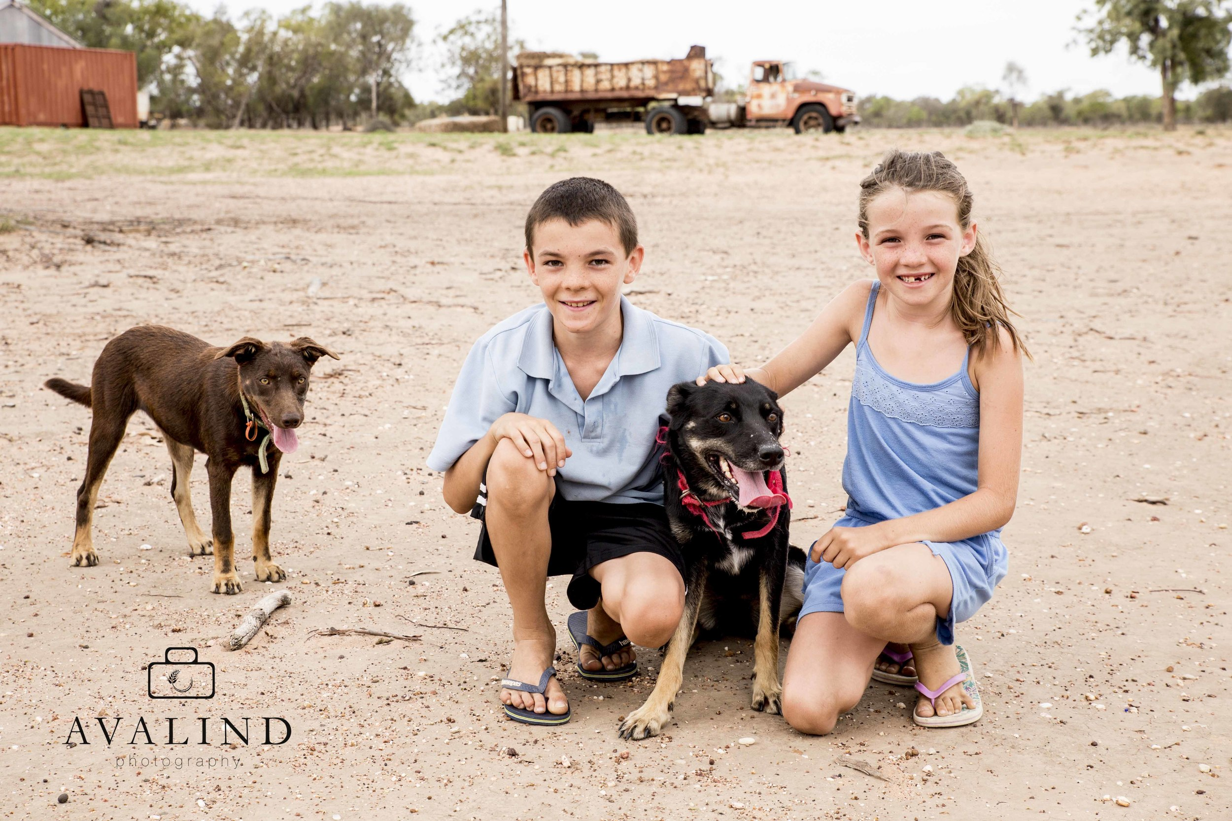 Michael & Victoria with best mates Sophie and Molly the kelpies. Two years ago the property was flooded in for months and it hasn't rained since.