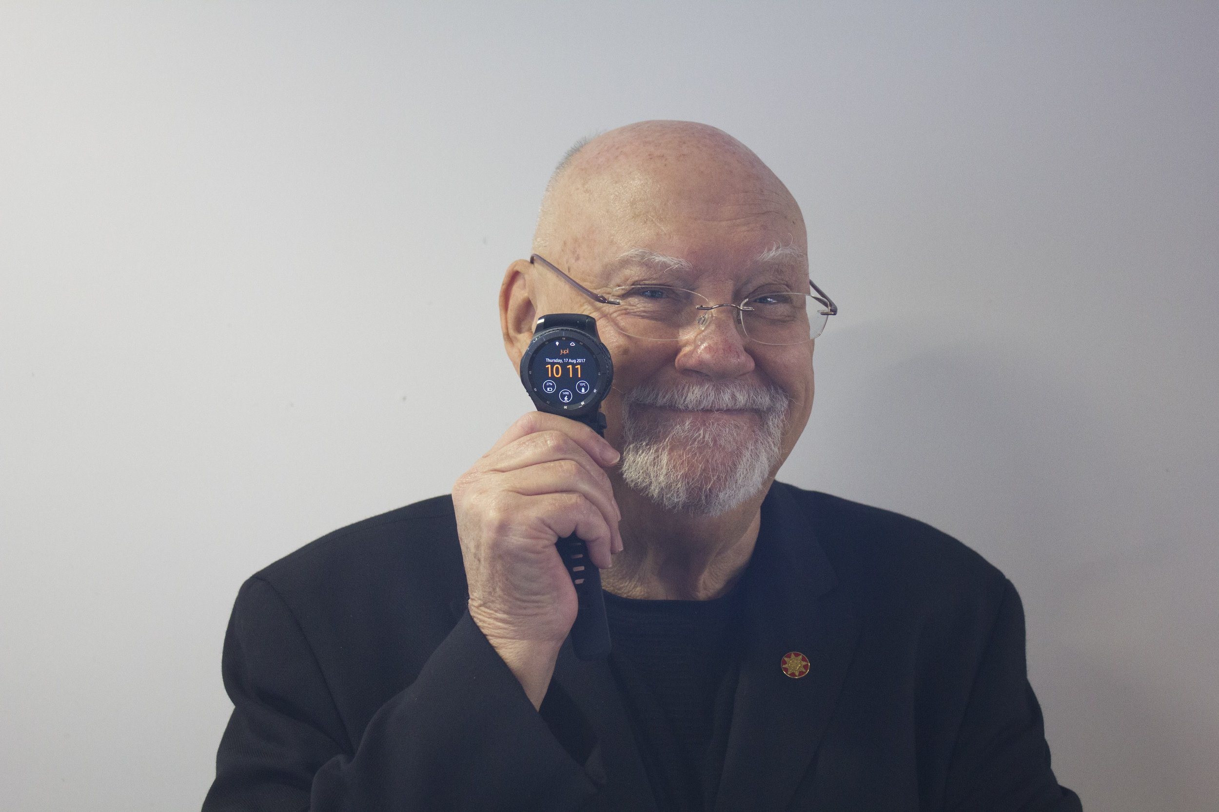 Sir Ray Avery holding the Jupl Safety Watch