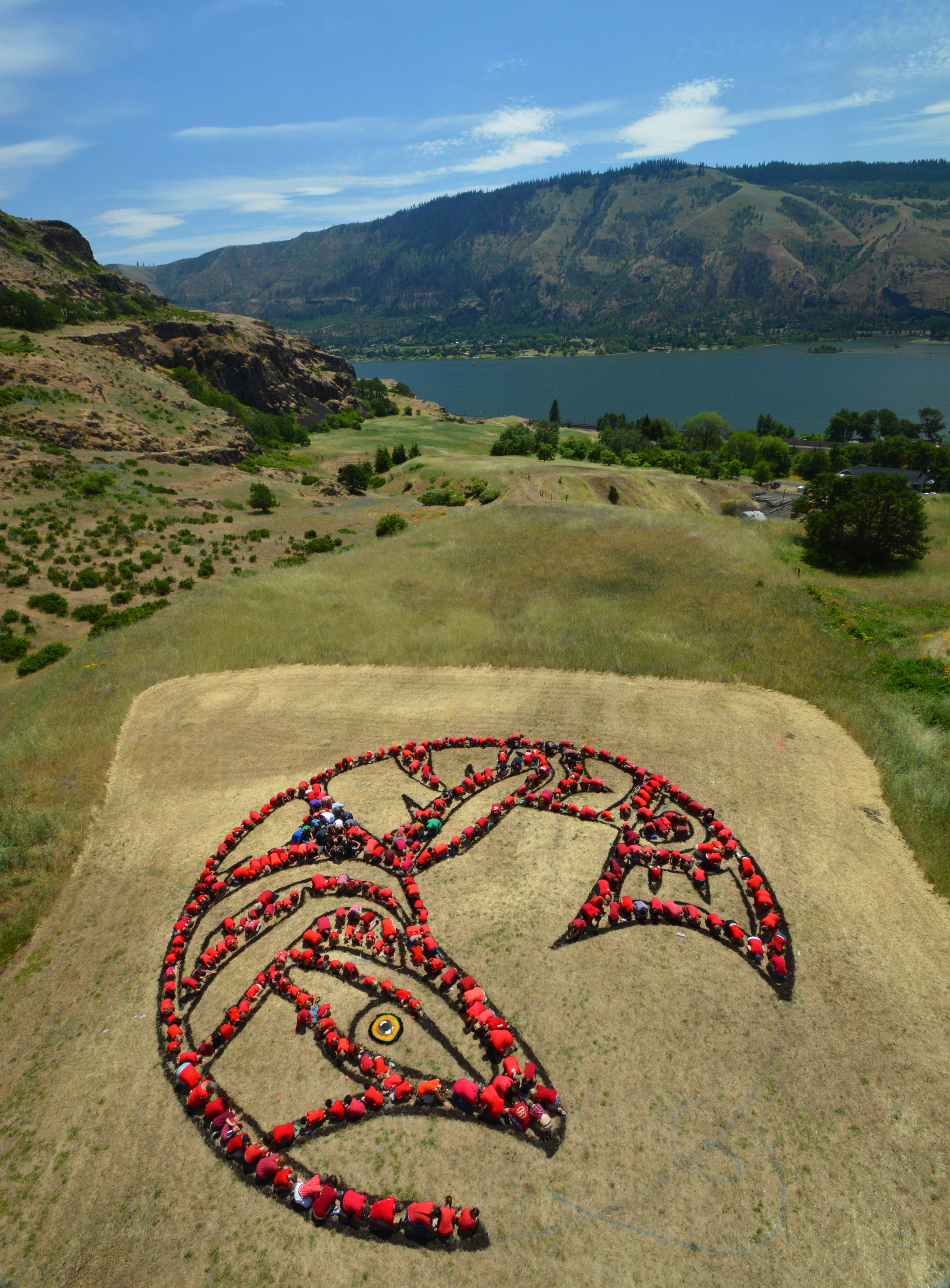 """""""Salmon Circle."""" People, fabric, mulch, leaves, recyclables. Printed with permission on page 58 in   Honoring Our Rivers   Issue 18."""