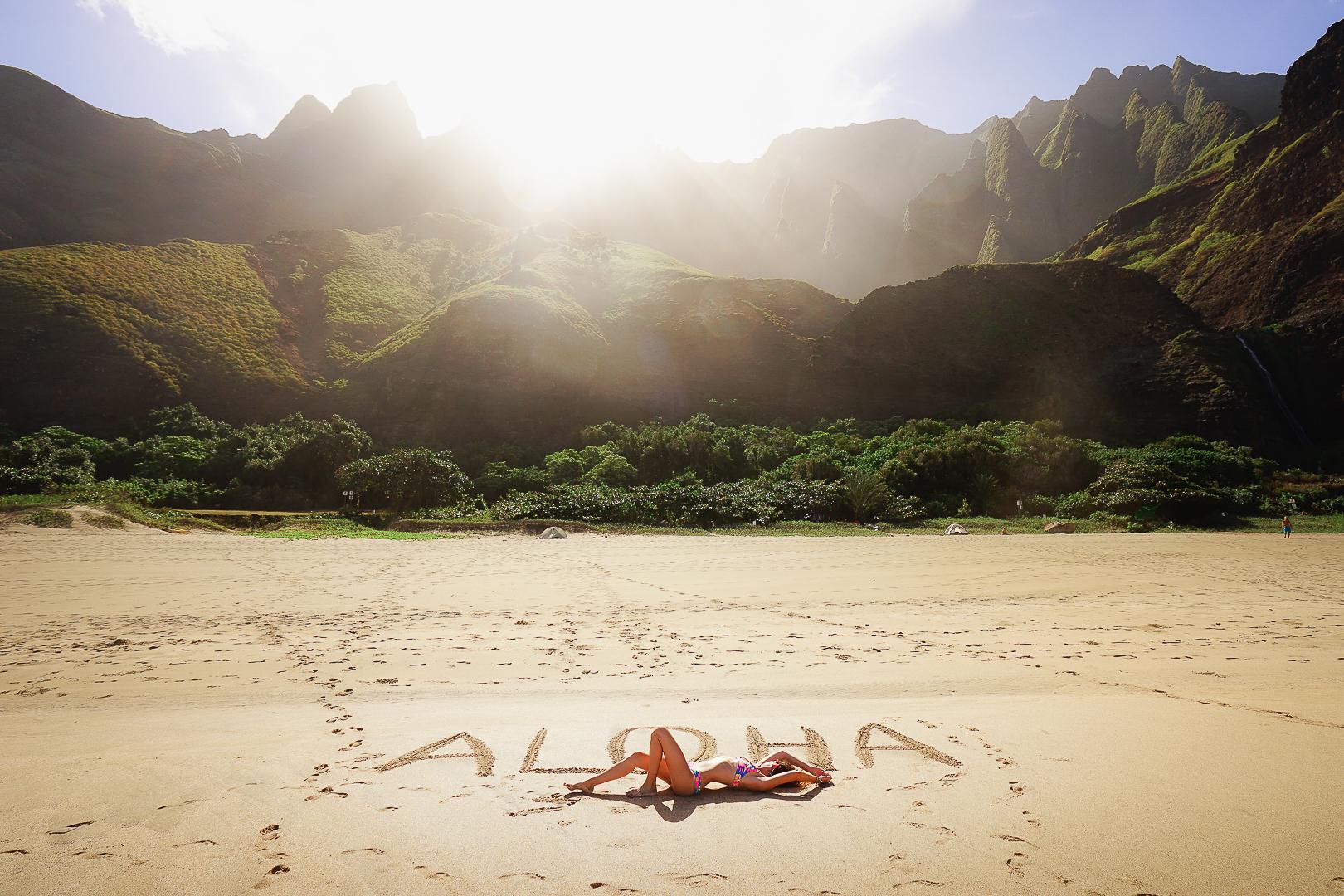 Jess Wandering relaxing on Kalalau Beach in Kauai.