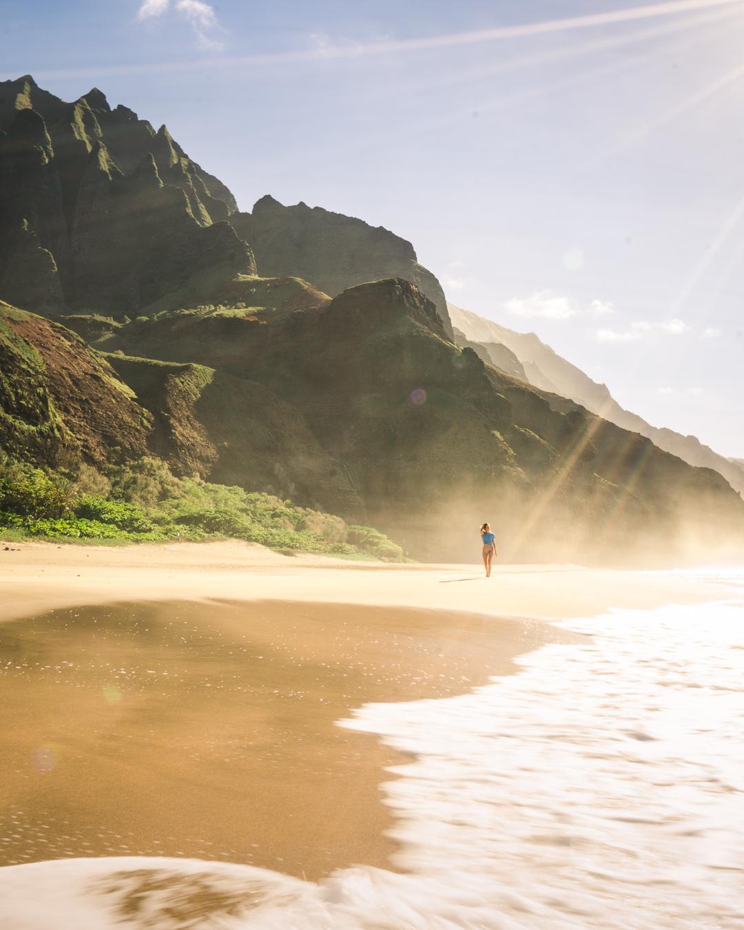 Walking along Kalalau  Beach on Kauai's Na Pali Coast.