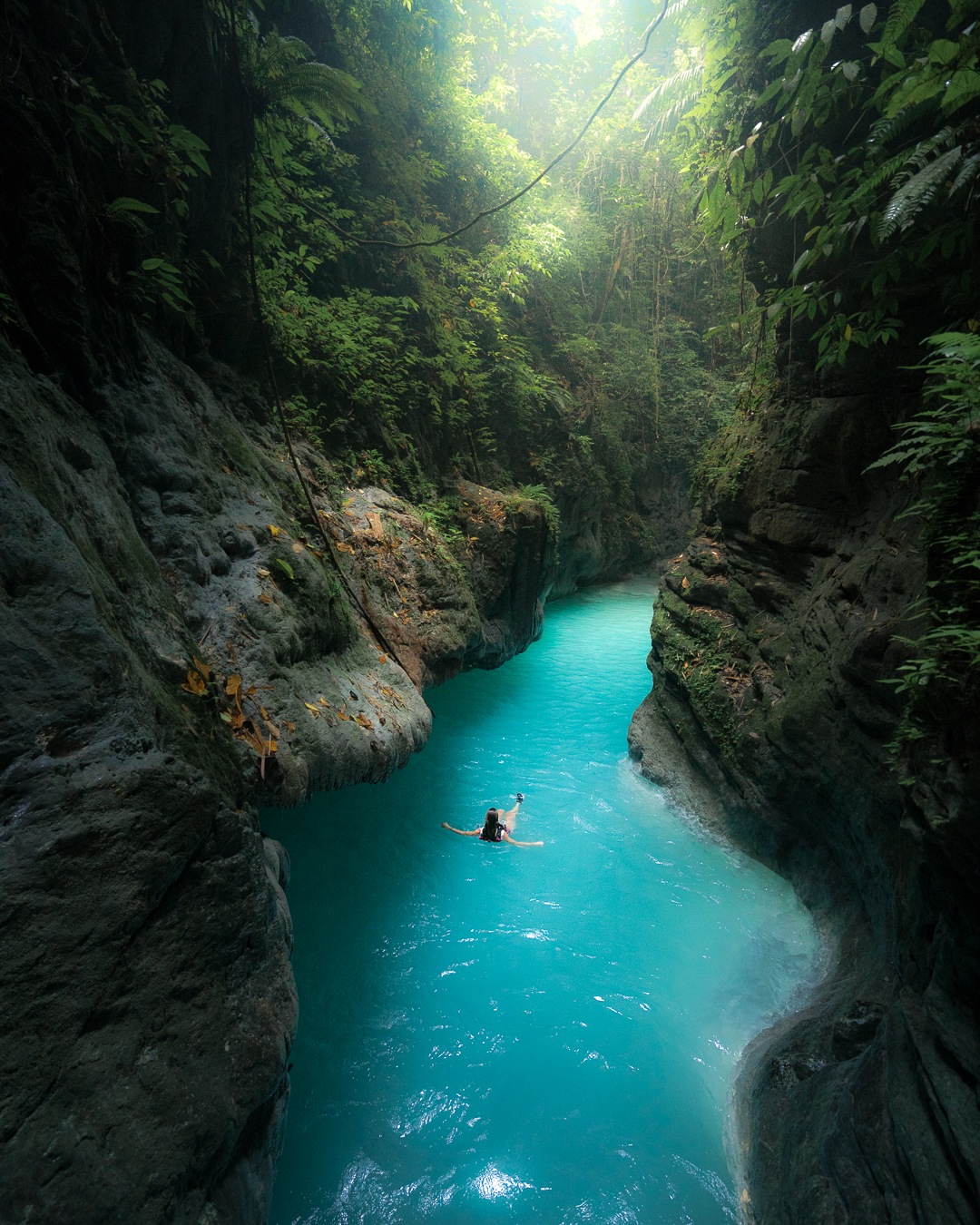 Floating down Kawasan Canyon on Cebu Island in the Philippines. Photo by Quin Schrock