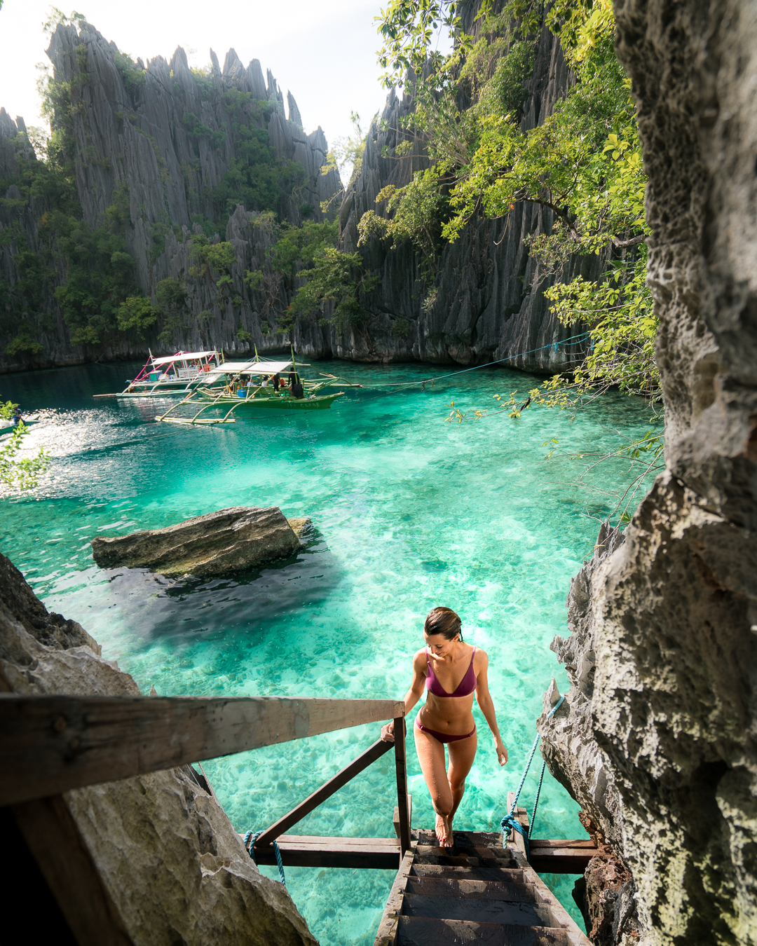 Walking on the staircase that separates the two bodies of water at Twin Lagoon in Coron, Philippines.