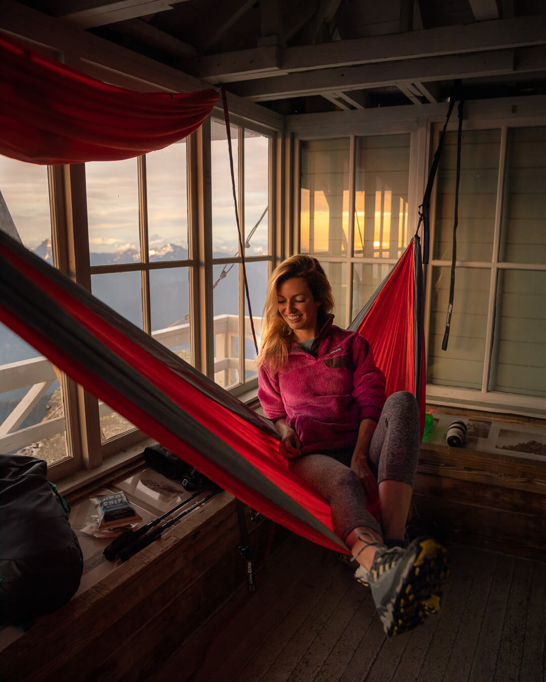 Hanging out in the Mount Pilchuck fire lookout. Wearing:  trail running shoes ,  leggings ,  jacket ,  hammock  // Photo by  Kyle Kotajarvi