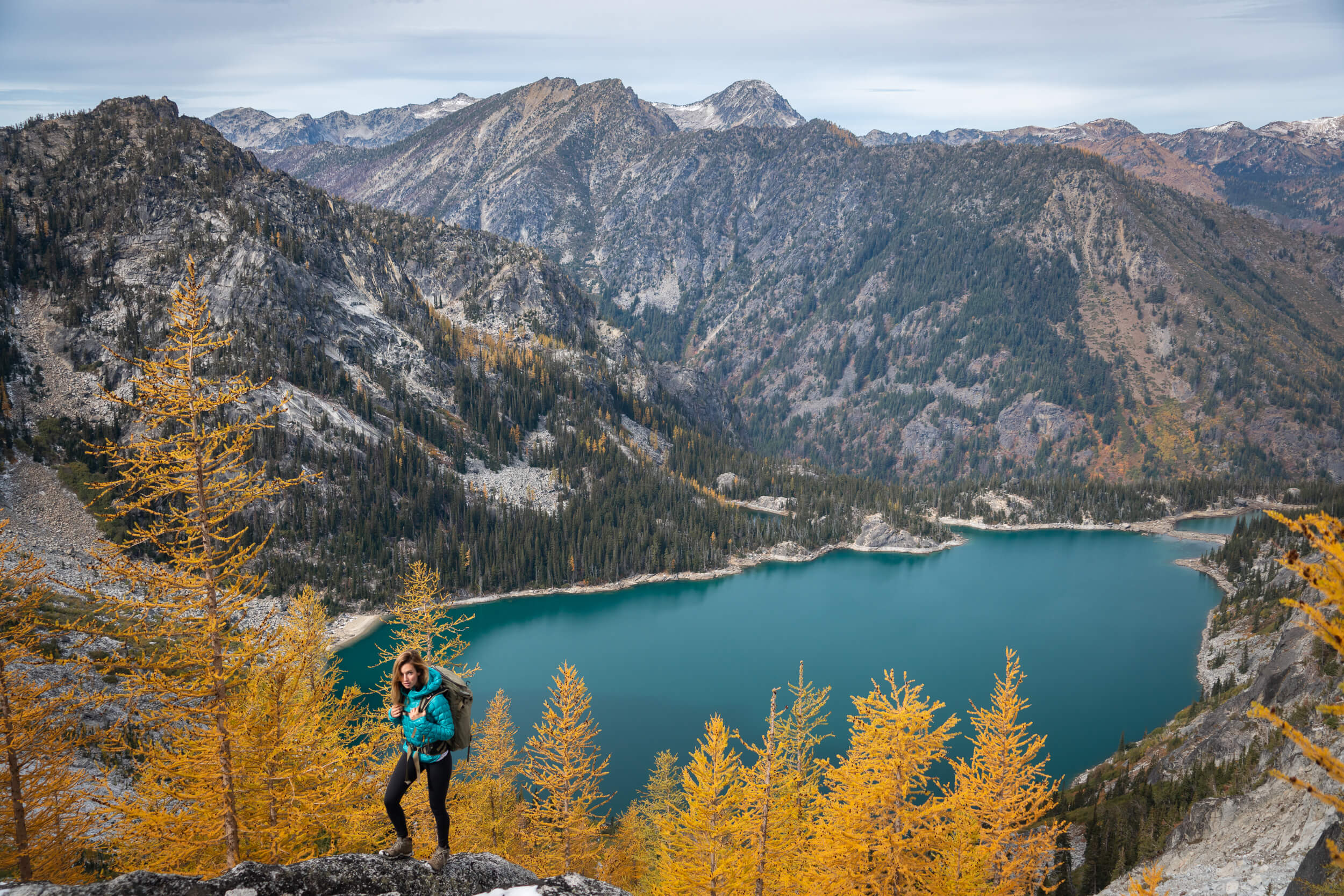 The Larches above Colchuch Lake generally turn cold in early October. Wearing: Prana  Pillar Legging , Rab  Down Jacket , Keen  Hiking Boots .