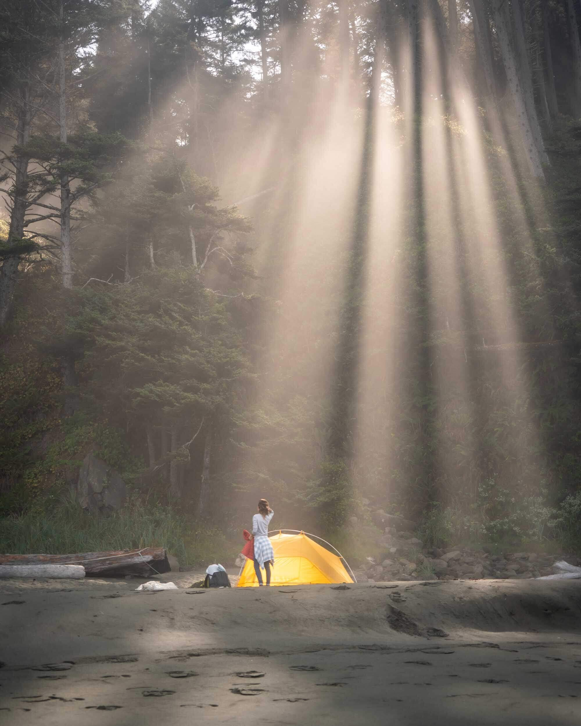 Amazing sun rays coming through the forest onto Shi Shi Beach in Washington. Wearing: The North Face  Long Sleeve Shirt  and Patagonia  Flannel Shirt . Also Shown: Big Agnes  2 Person Tent .