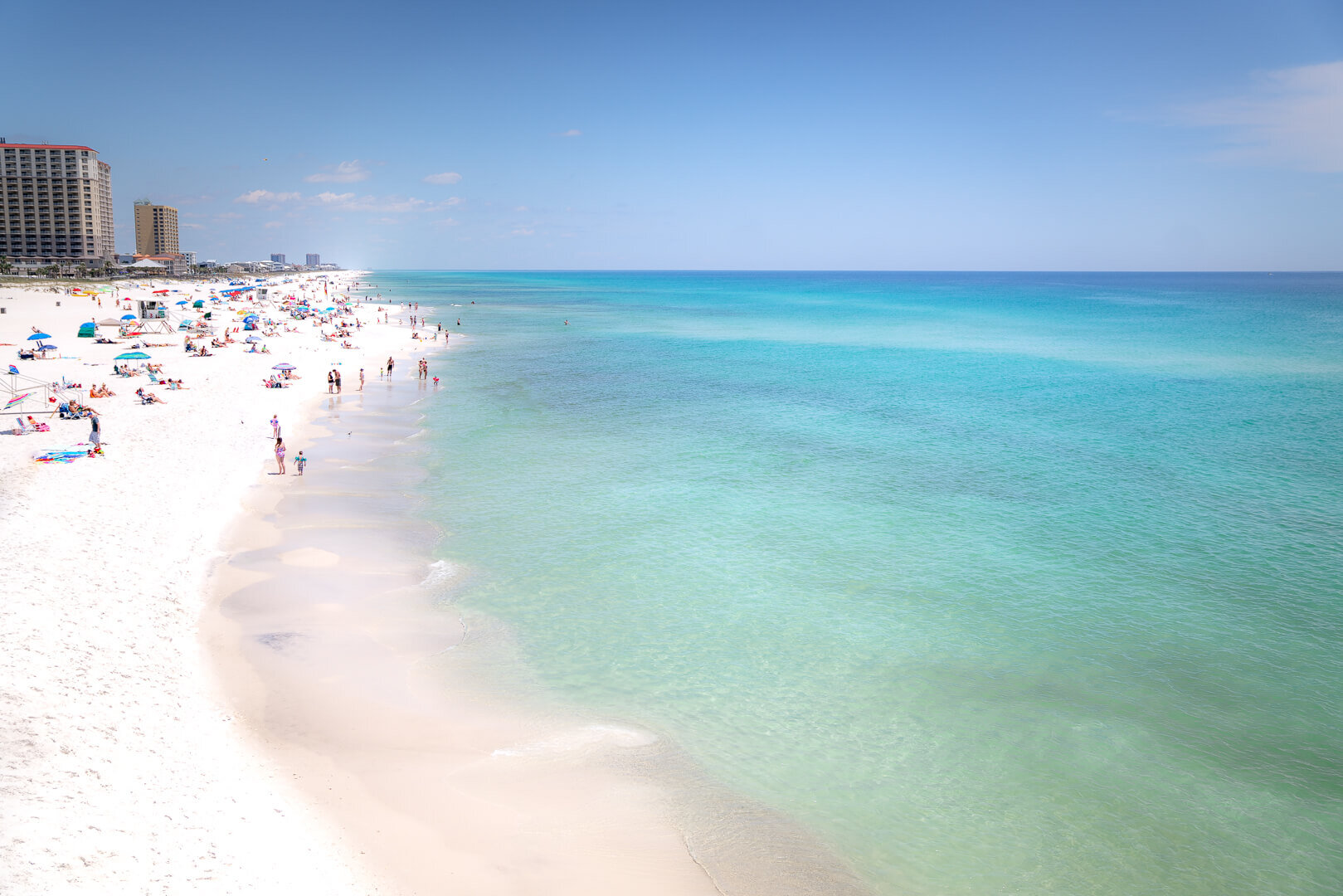 The view of Pensacola Beach from the enormous peer that jets out into The Gulf.