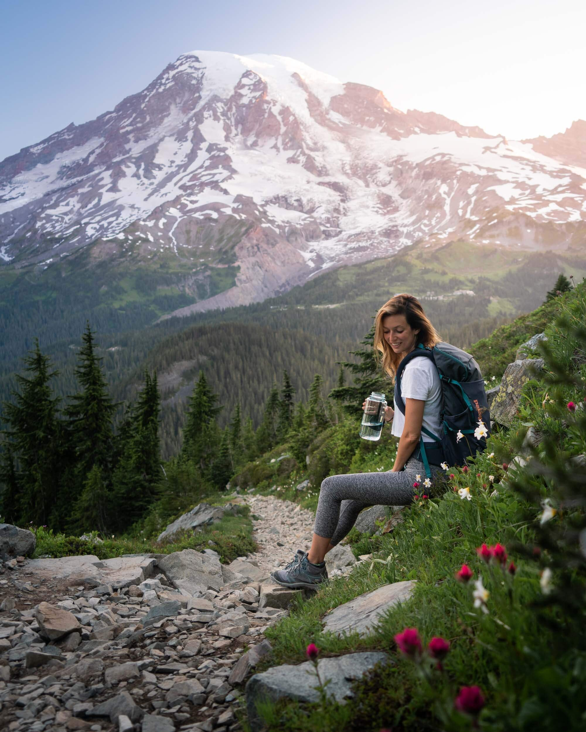 Taking a break on the Pinnacle Peak Trail at Mount Rainier. Wearing: Keen  Hiking Boots , Beyond Yoga  Leggings , Patagonia  Day Pack , and drinking out of my  Nalgene . View from Pinnacle Ridge at Mount Rainier.