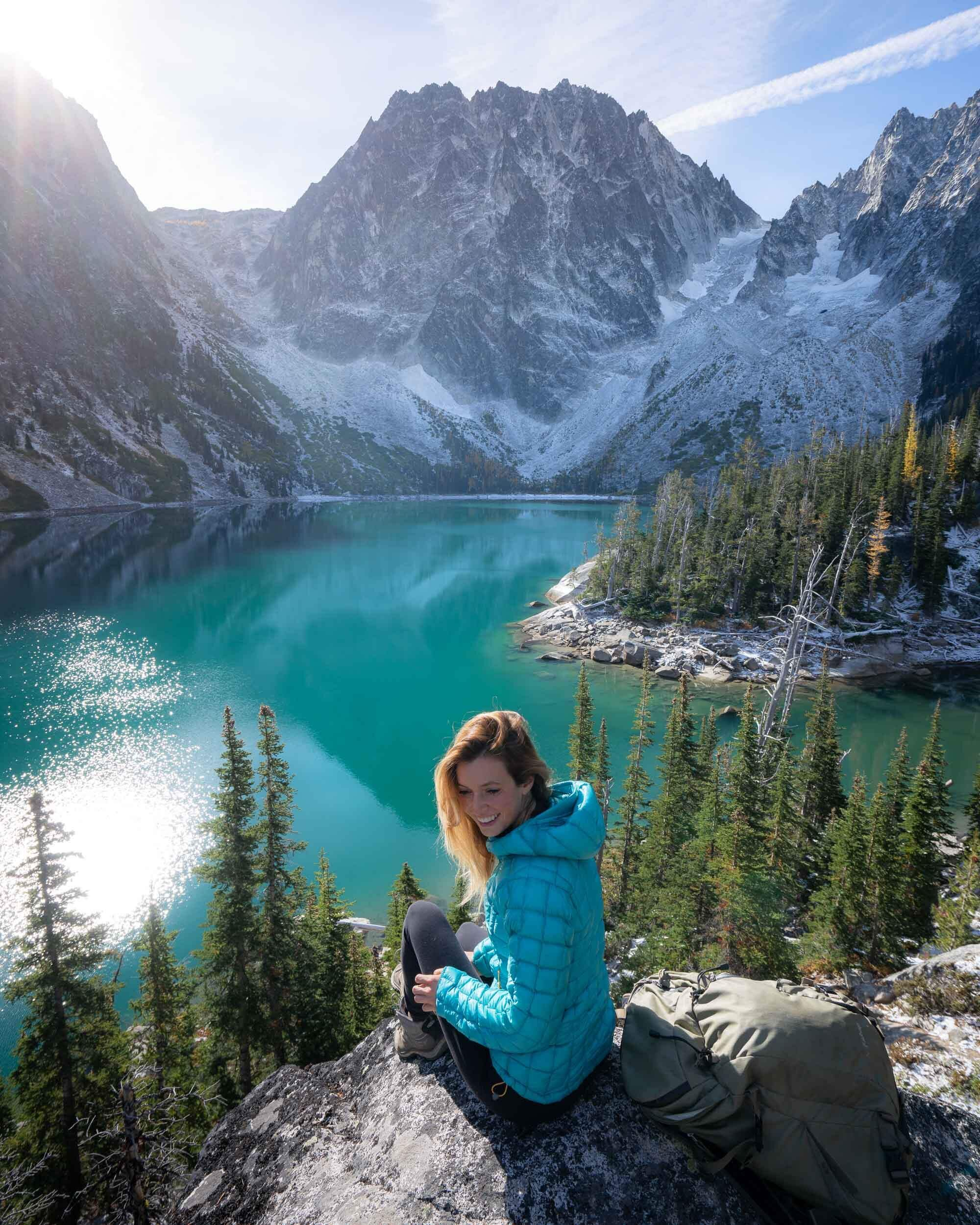 Colchuck Lake is one of the prettiest lakes in Washington's Alpine Lakes Wilderness. Wearing: Rab  Down Jacket , Keen  Hiking Boots .