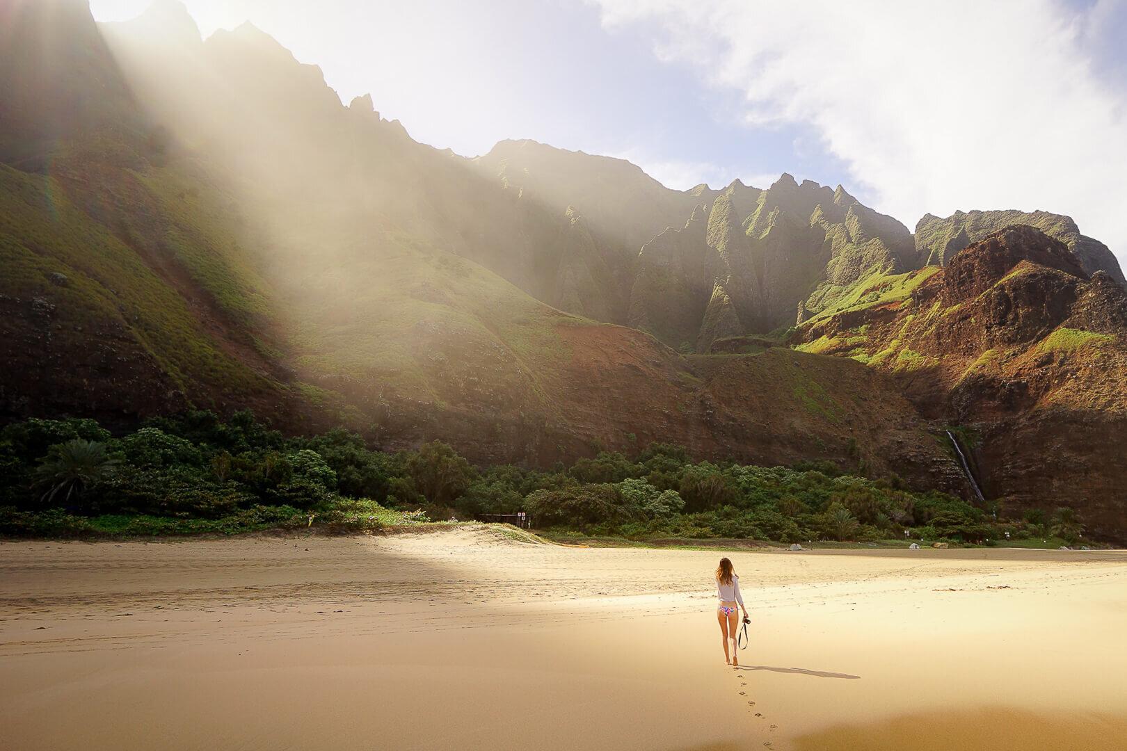 Walking on Kalalau Beach on Kauai's Nā Pali Coast.