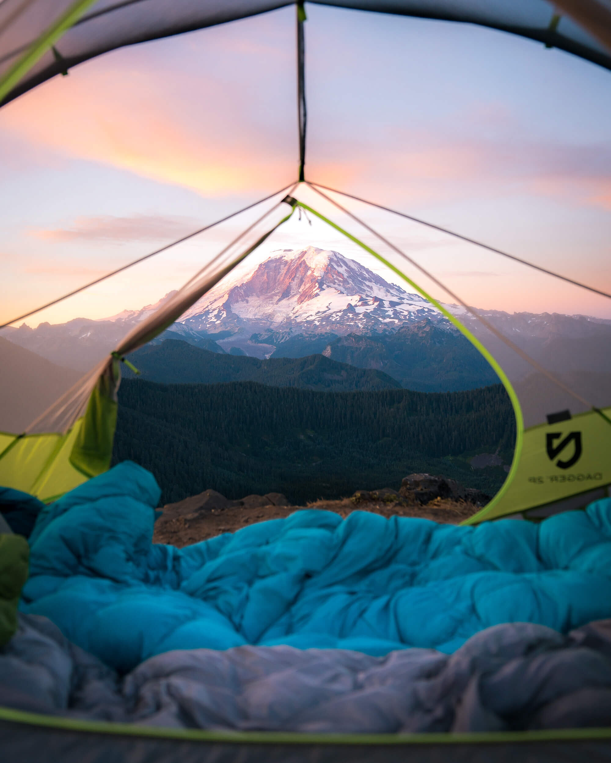 Camp spot at with a view of Mount Rainier in the distance. Shown in photo:  NEMO Equipment Tent , Marmot 15 Degree  Sleeping Bag .