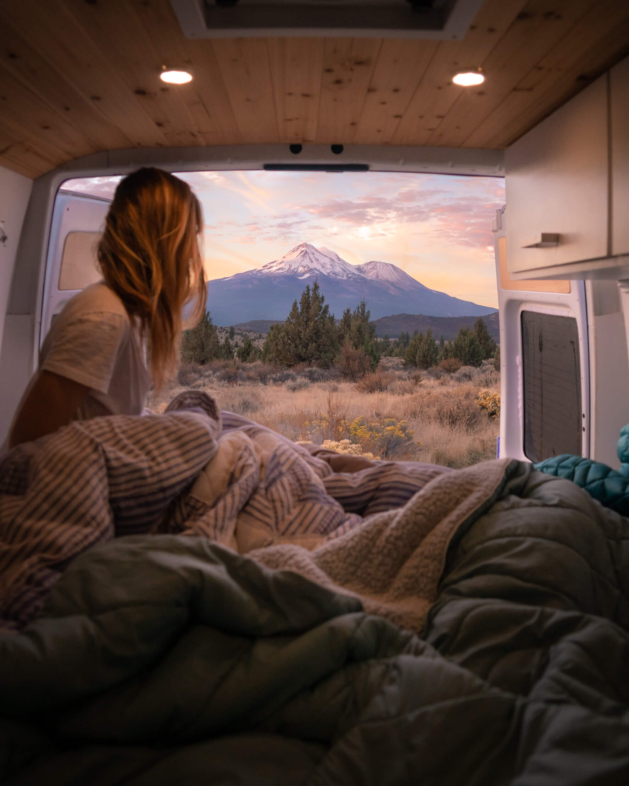 Taking in a spectacular sunrise over Mount Shasta from the back of our camper van.