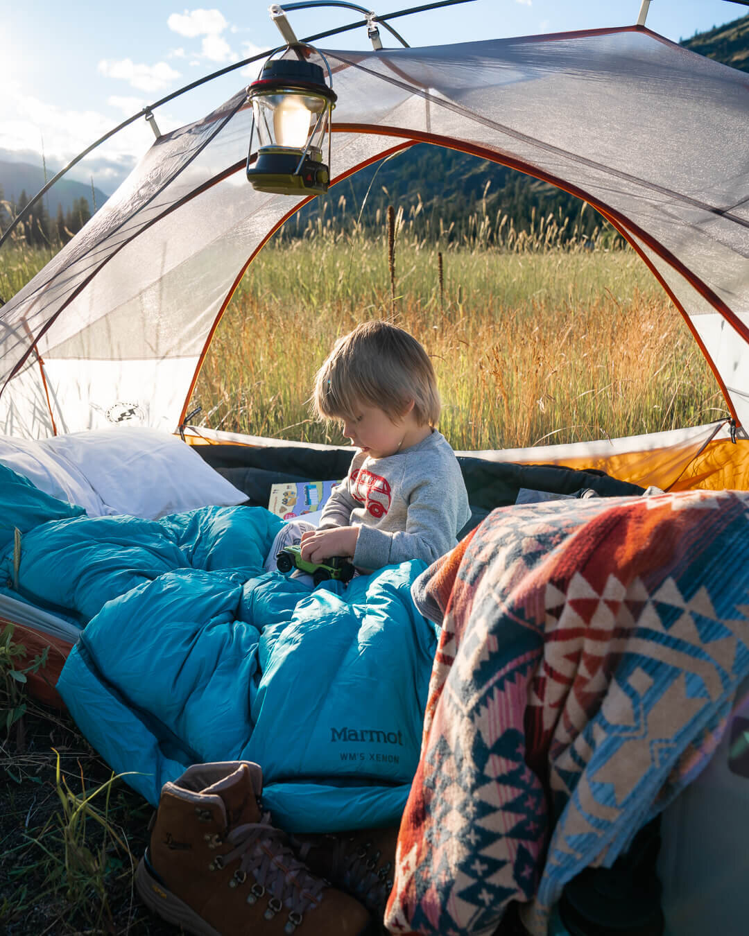 Camping in the yard for the first time! Shown in photo: Danner  Hiking Boots , Pendleton  Towel , Goal Zero  Lantern , Big Agnes Copper Spur  Tent .