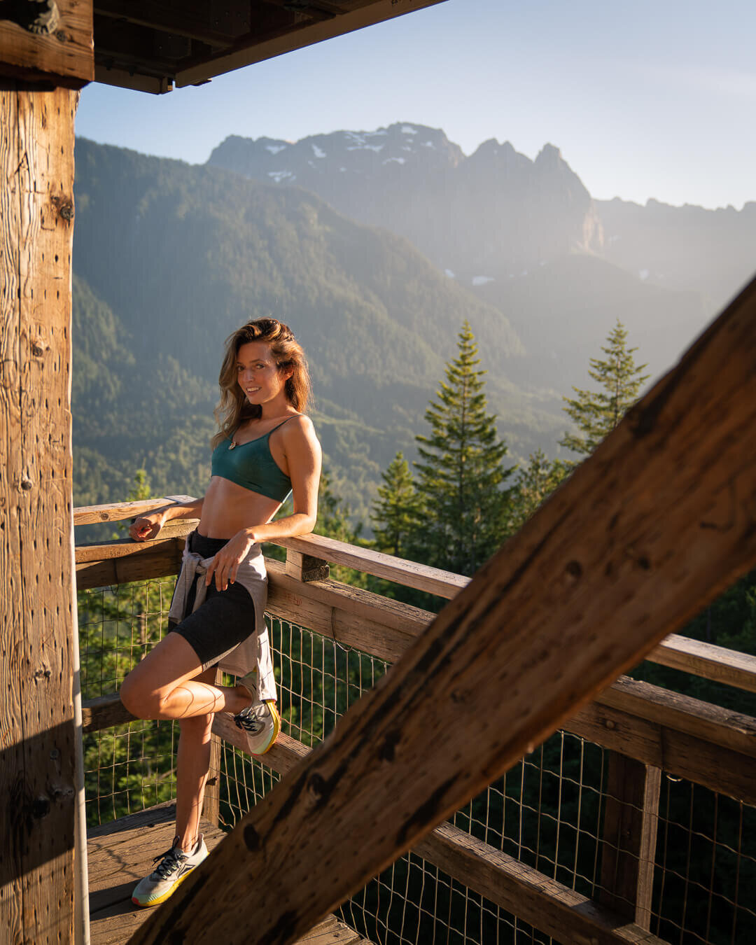 Heybrook Lookout at sunset. Wearing: Nike  Trail Running Shoes , Beyond Yoga  Biker Shorts , Patagonia  Bra , The North Face  HyperLayer Long Sleeve ,.