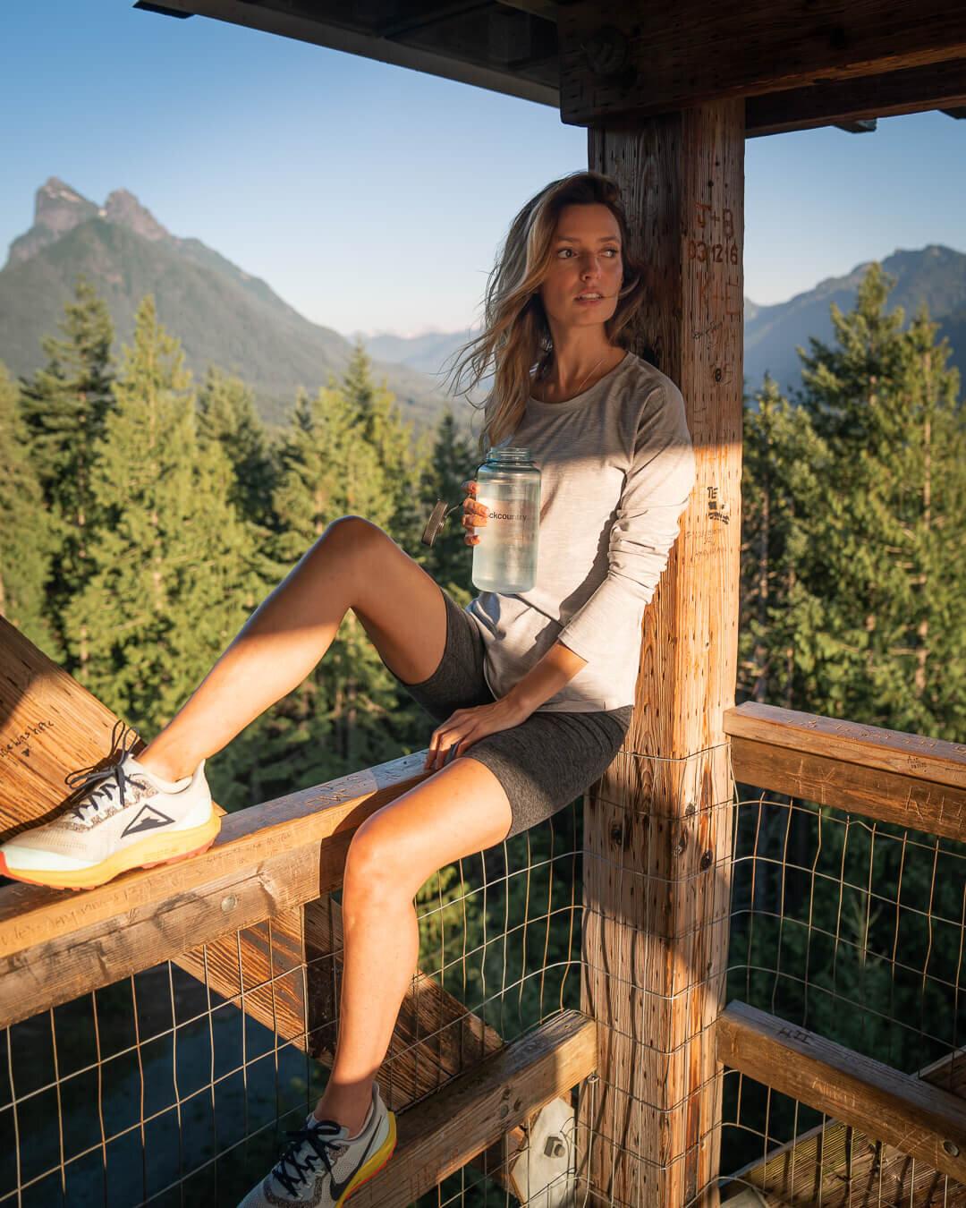 Heybrook Lookout at sunset. Wearing: Nike  Trail Running Shoes , Beyond Yoga  Biker Shorts , The North Face  HyperLayer Long Sleeve , Nalgene  Water Bottle .