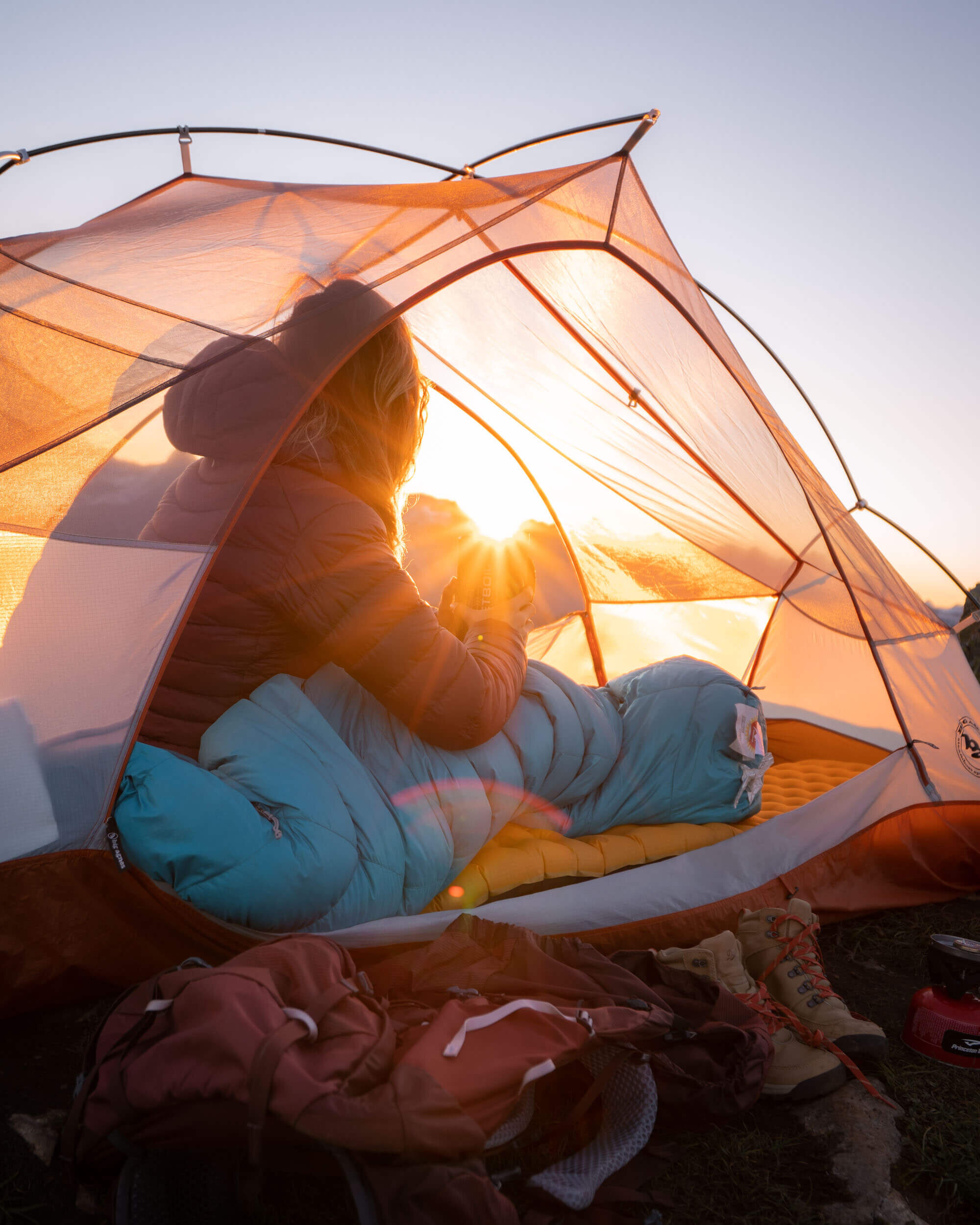 Waking up at sunrise in the North Cascades. Wearing:  Arc'teryx Cerium LT Hooded Down Jacket . Also shown:  Marmot Women's Xenon 15° Sleeping Bag ,  NEMO Sleeping Pad ,  Big Agnes Copper Spur HV UL 2P Tent .