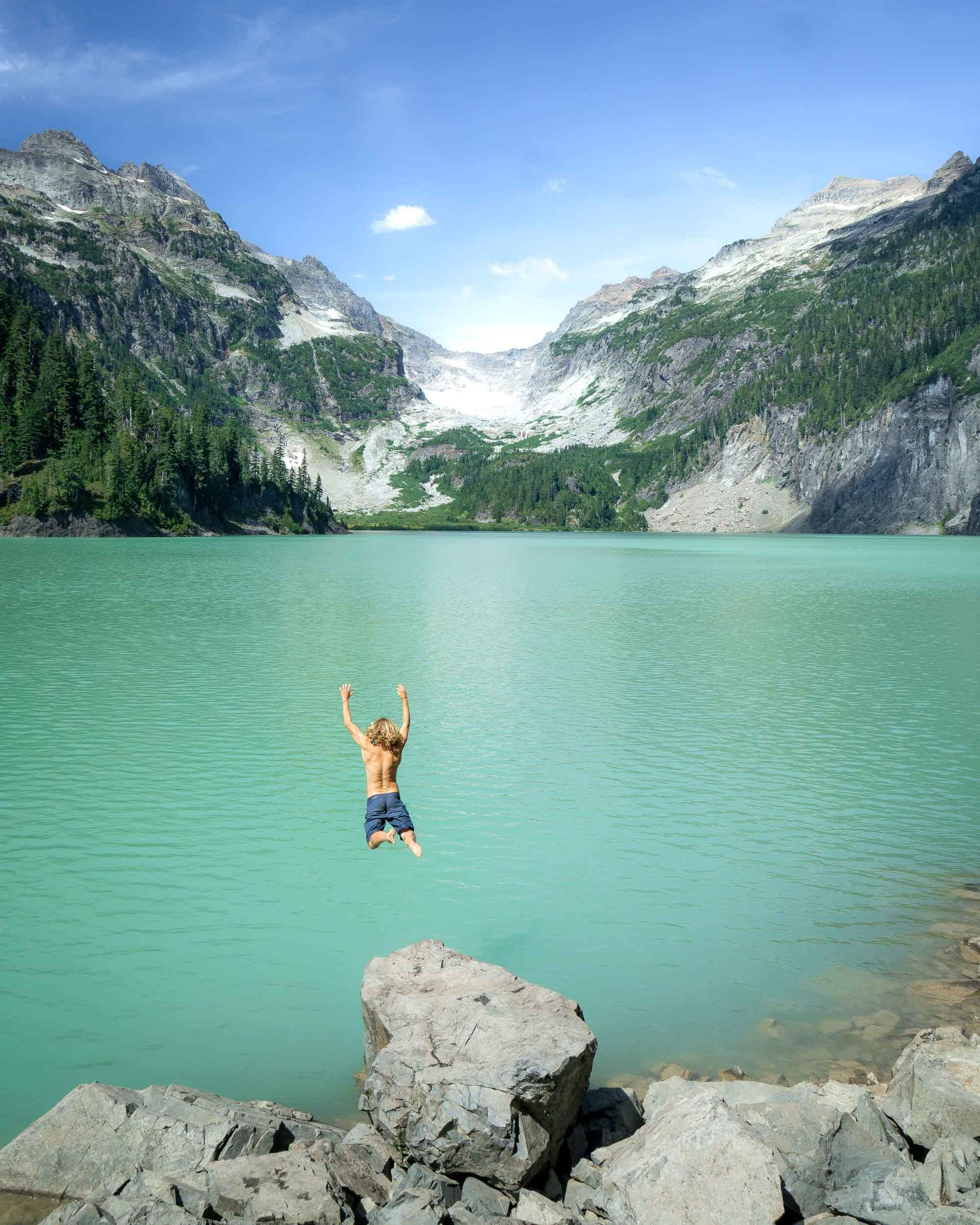 Quin jumping into the glacial water at  Blanca Lake .