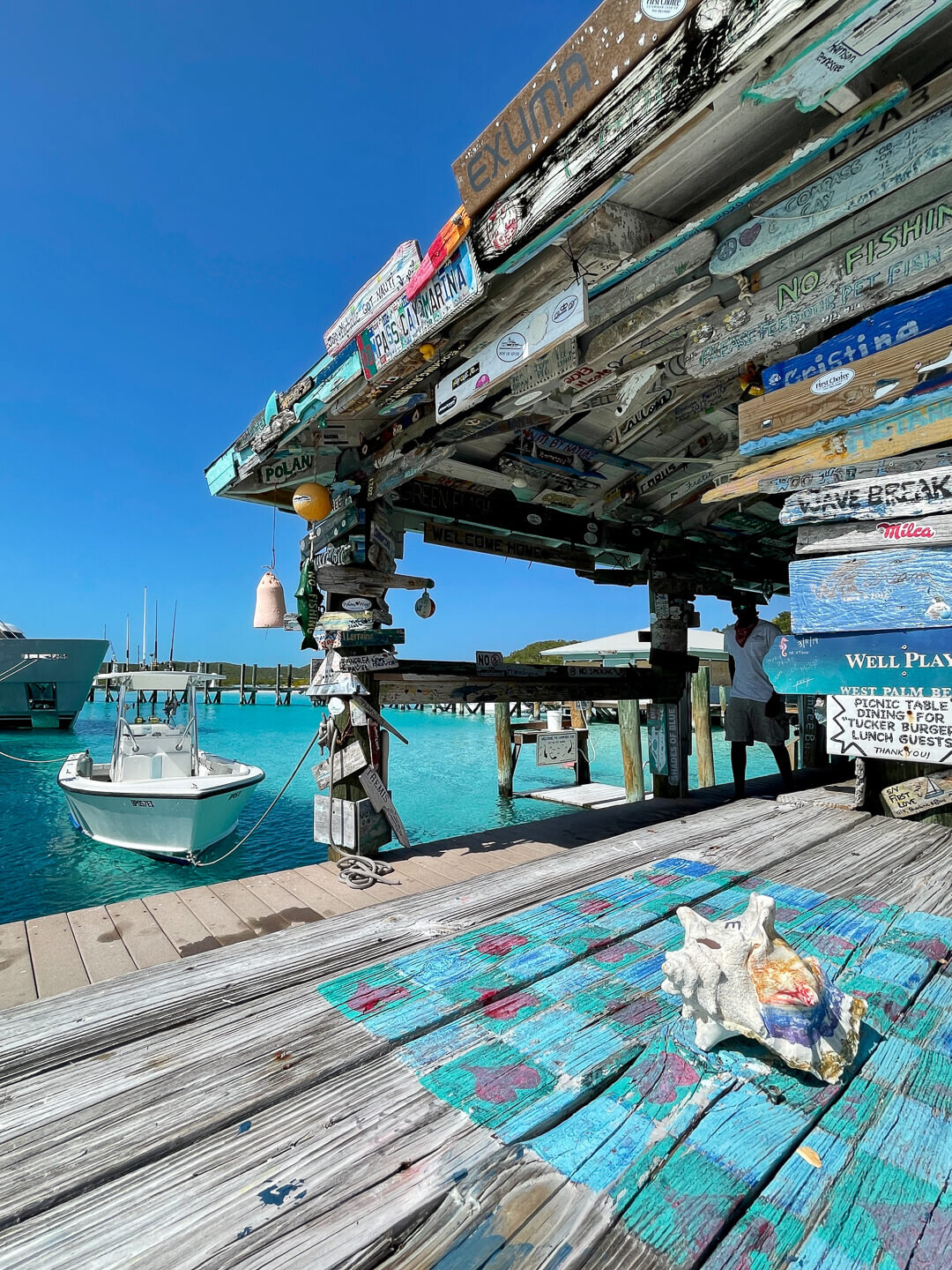 Colorful wood signs left by past travelers give Compass Cay its quirky character.