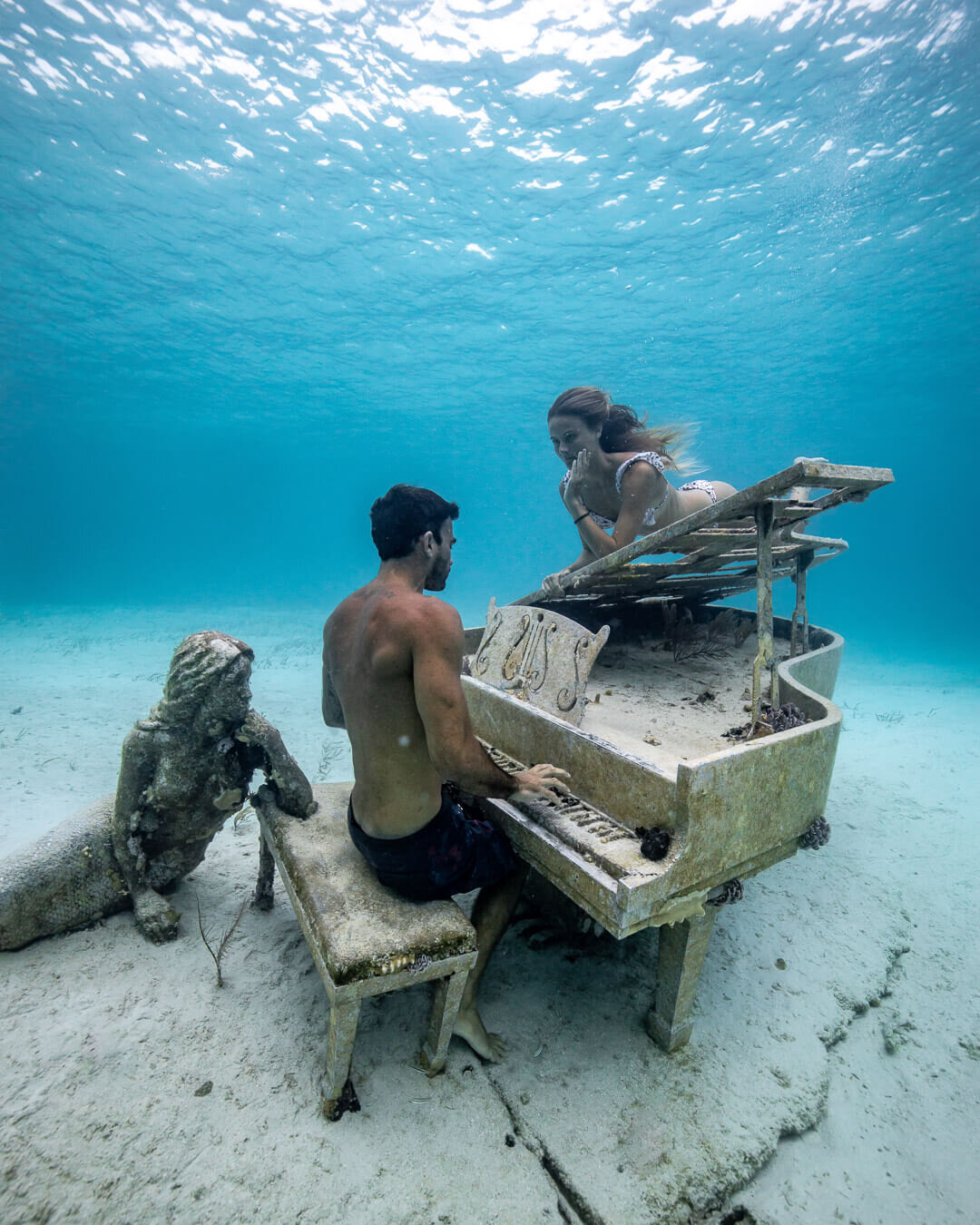 David Langlois  playing the piano for  Lauren Landers  at The Musician. David and Lauren run charter trips through The Bahamas on their sailboat  Boomsharkalaka . Photo by:  Quin Schrock .