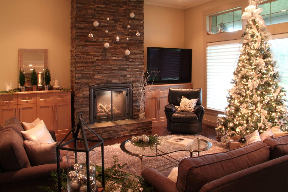 In the living room, we used the owner's existing leather recliner and glass table and brought in custom chosen couch and love seat, plus silver accent rug, throw pillows and Christmas decor courtesy of local providers.