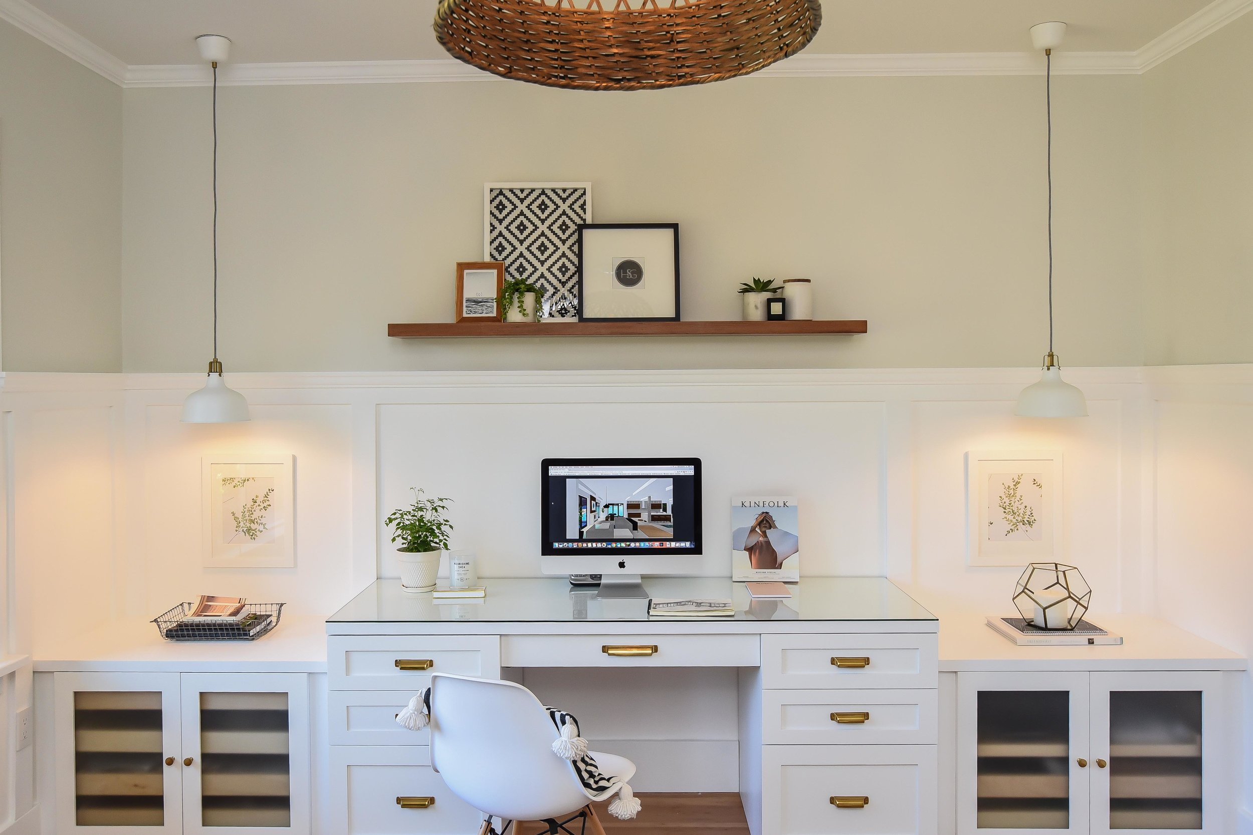 We completely redesigned and renovated this former bedroom into the new home for our studio.In order to create value for resale or rental at a later date, we designed this so that the desk can be pulled out and replaced with a queen bed. The side tables then become night tables.