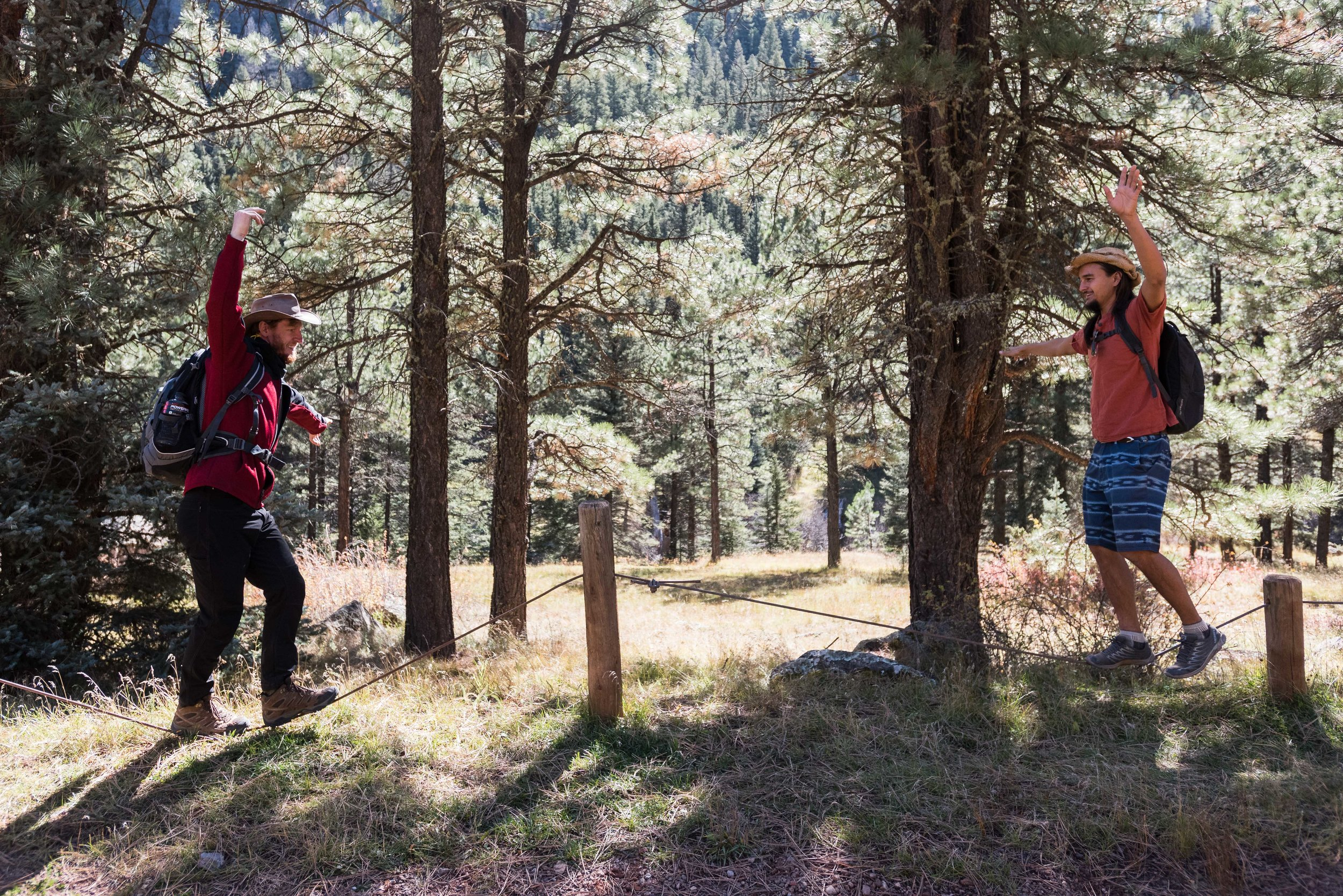 Peter and Chris doing some slacklining along forest road 376