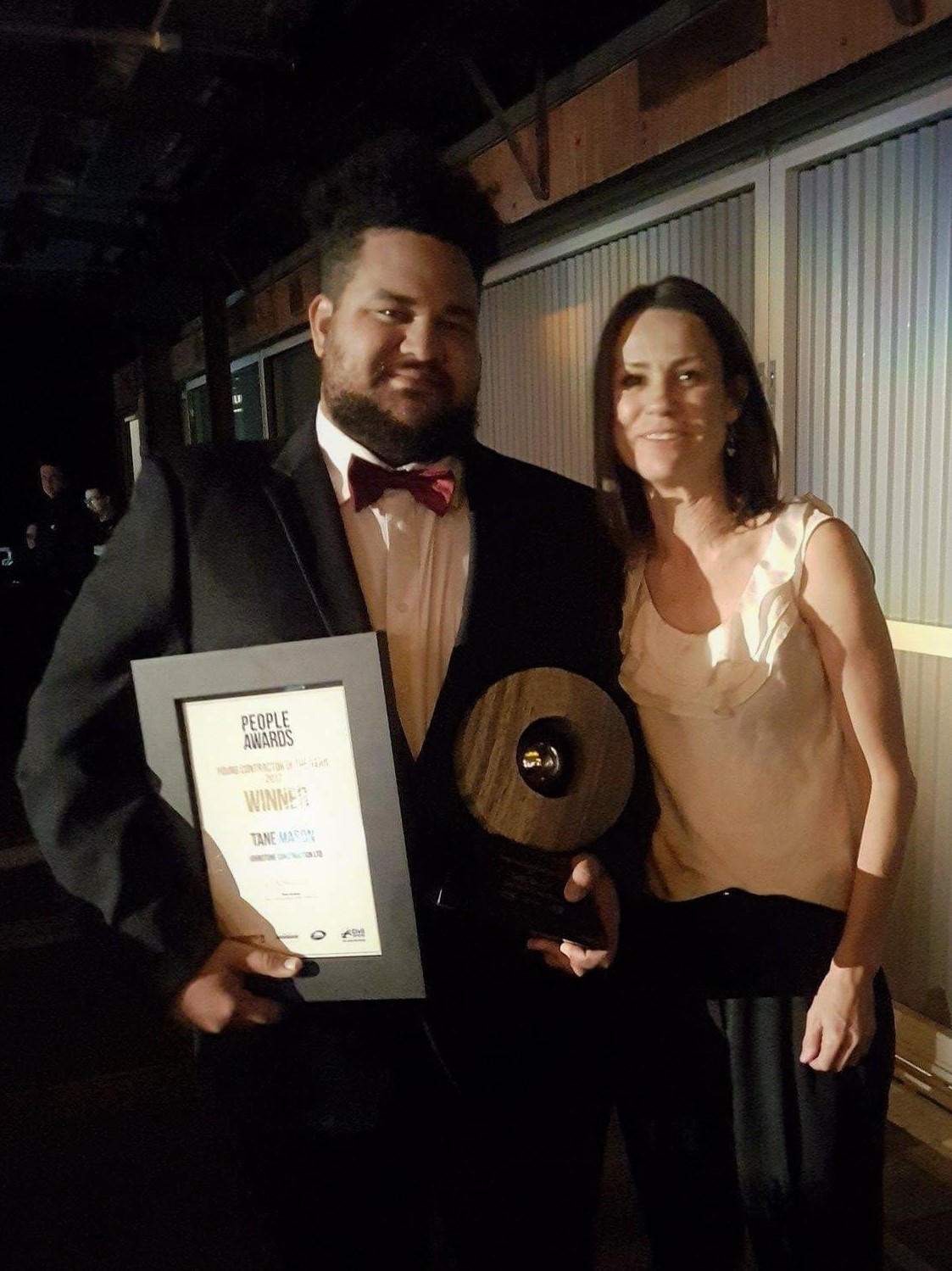 Johnstone Construction's Operations Manager Susy Pryde congratulates Tane Mason